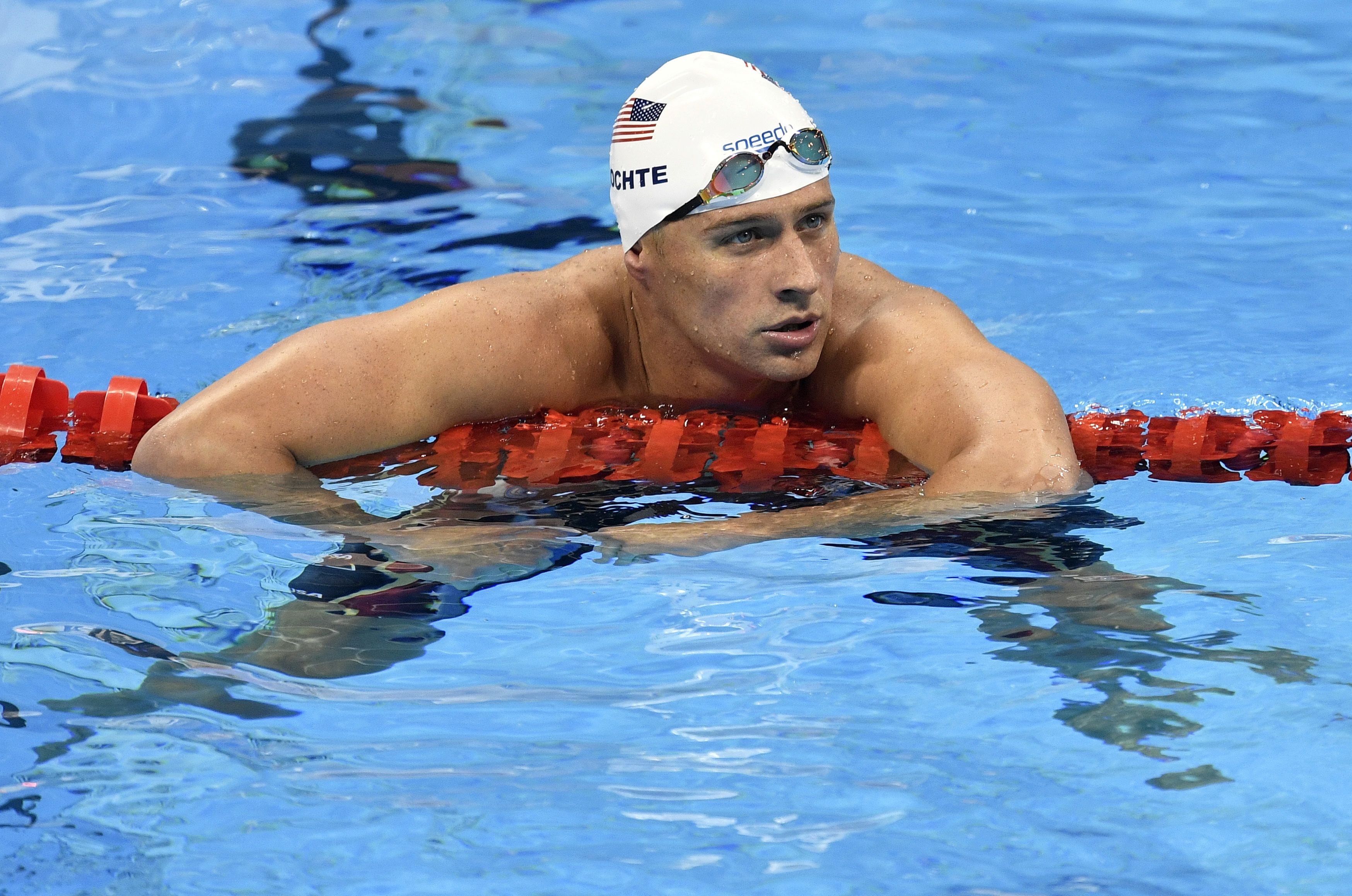 FILE - In this Aug. 9, 2016, file photo, United States' Ryan Lochte checks his time after a men' 4x200-meter freestyle relay heat during the swimming competitions at the 2016 Summer Olympics in Rio de Janeiro, Brazil. A Brazilian police official told The