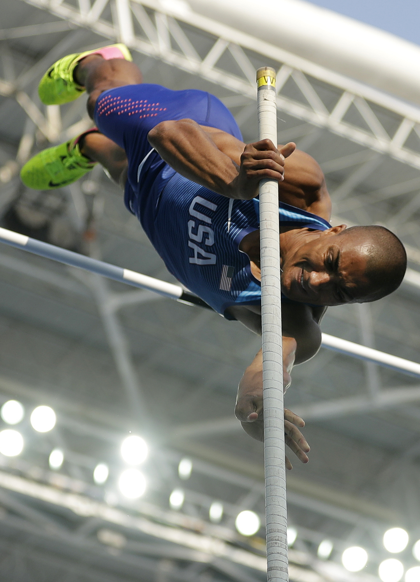 United States' Ashton Eaton competes in men's decathlon pole vault during the athletics competitions of the 2016 Summer Olympics at the Olympic stadium in Rio de Janeiro, Brazil, Thursday, Aug. 18, 2016. (AP Photo/Matt Dunham)
