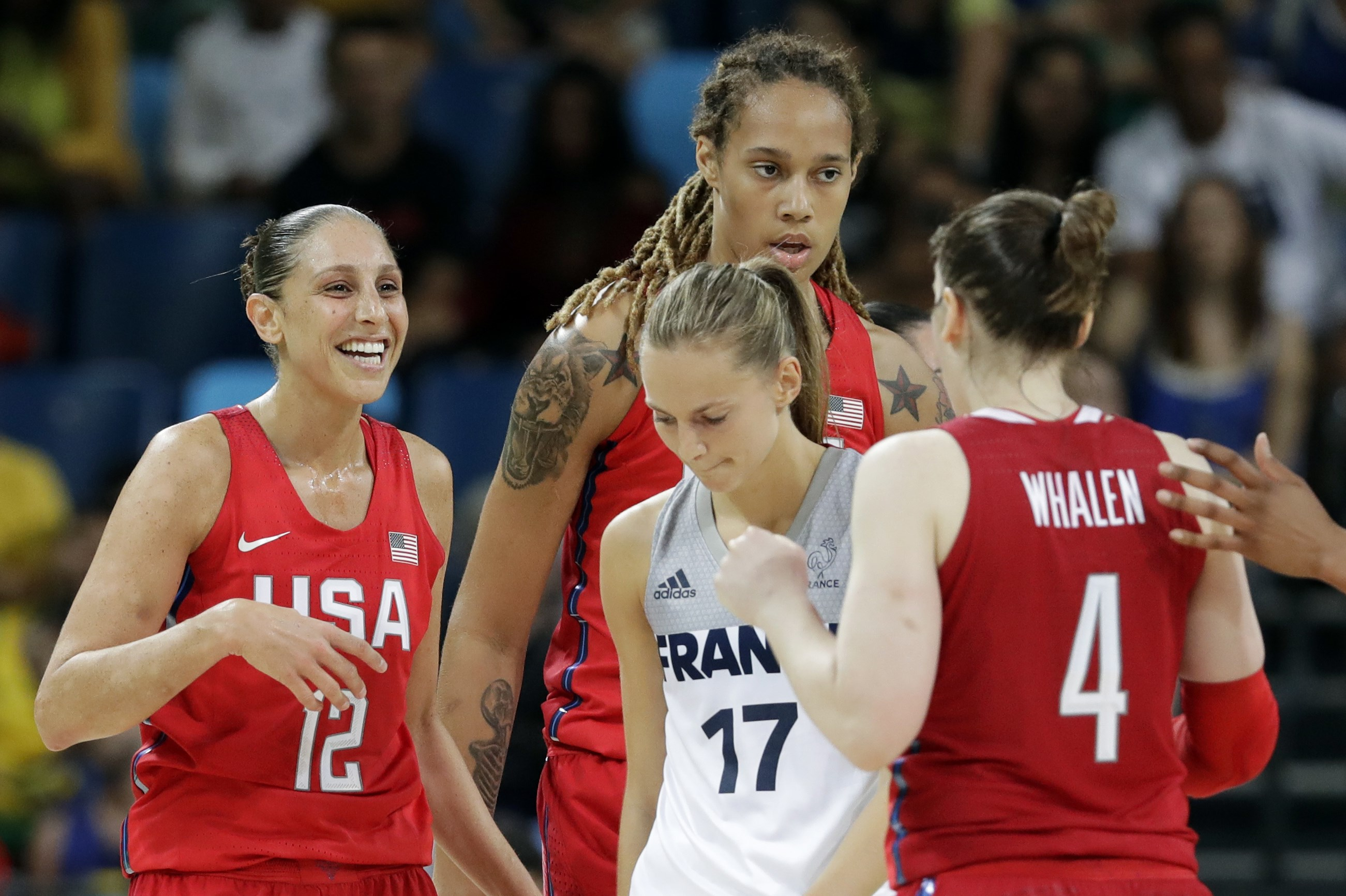 United States' Diana Taurasi (12) celebrates with teammates Lindsay Whalen (4) and Brittney Griner, rear, in front of France's Marine Johannes (17) during a semifinal round basketball game at the 2016 Summer Olympics in Rio de Janeiro, Brazil, Thursday, A