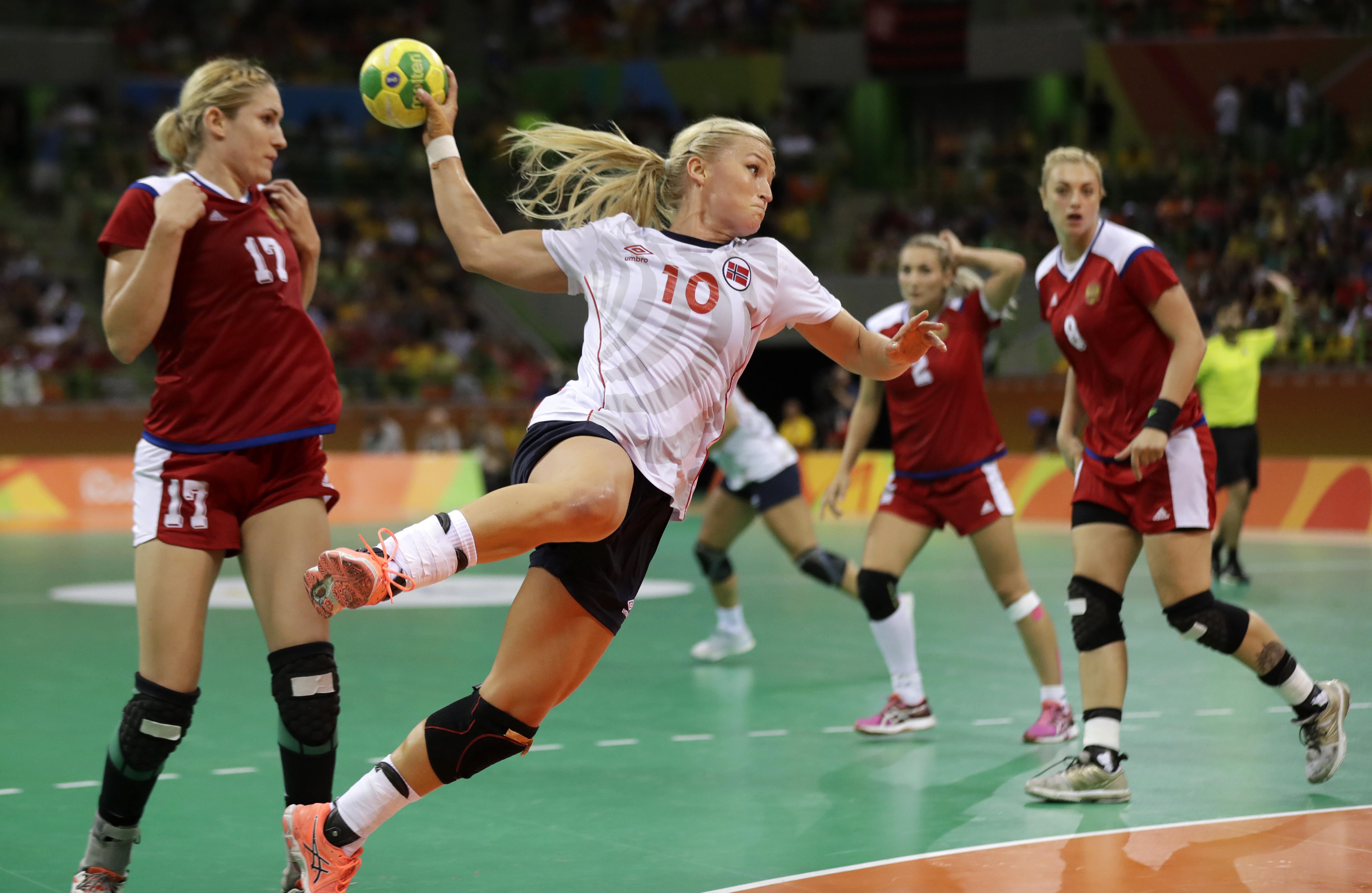 Norway's Stine Bredal Oftedal tries to score past Russia's Vladlena Bobrovnikova, left, during the women's semifinal handball match between Norway and Russia at the 2016 Summer Olympics in Rio de Janeiro, Brazil, Thursday, Aug. 18, 2016. (AP Photo/Ben Cur