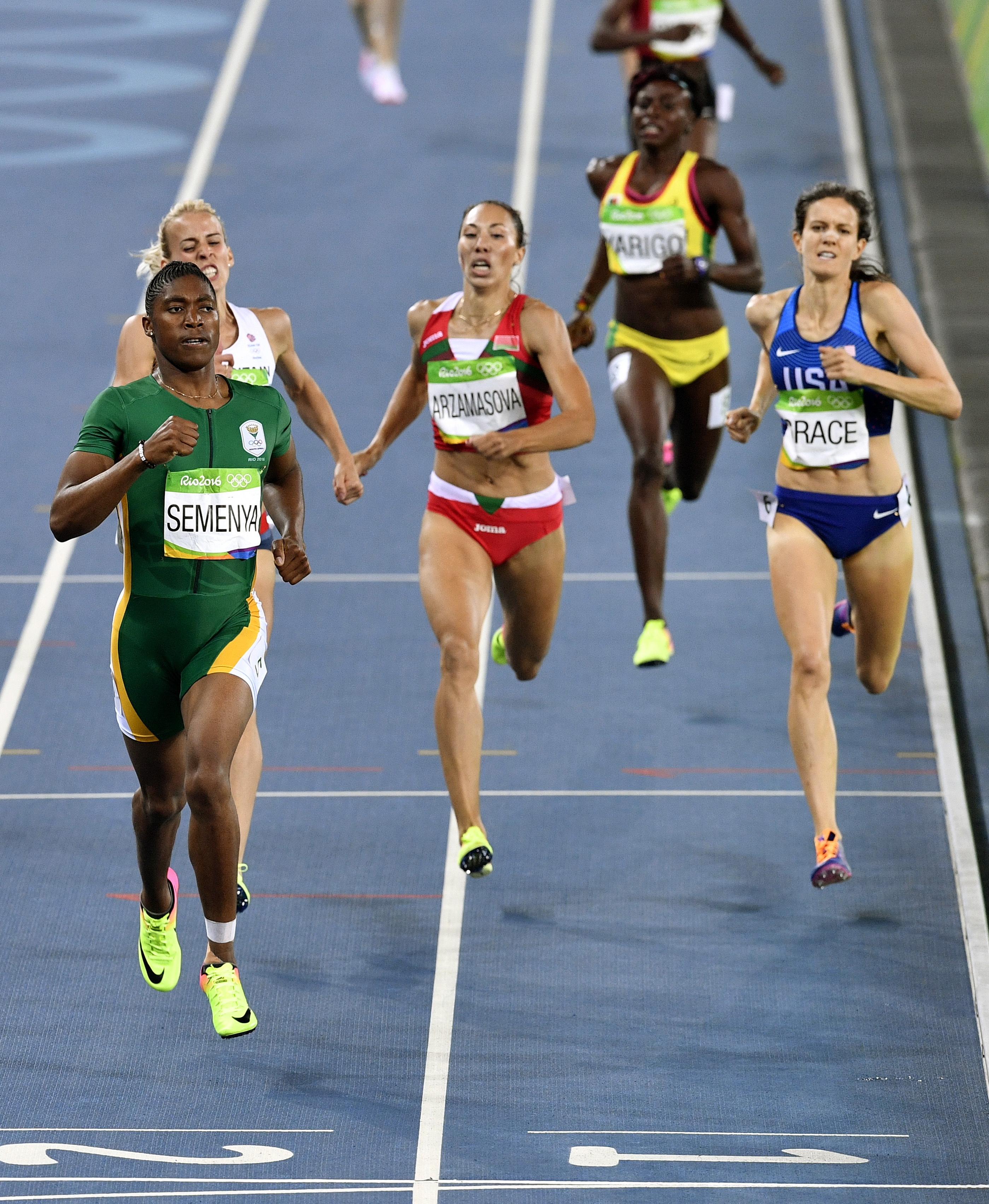 South Africa's Caster Semenya, left, Britain's Lynsey Sharp, second left, Belarus' Marina Arzamasova, center, and United States' Kate Grace, right, compete in a women's 800-meter semifinal during the athletics competitions of the 2016 Summer Olympics at t