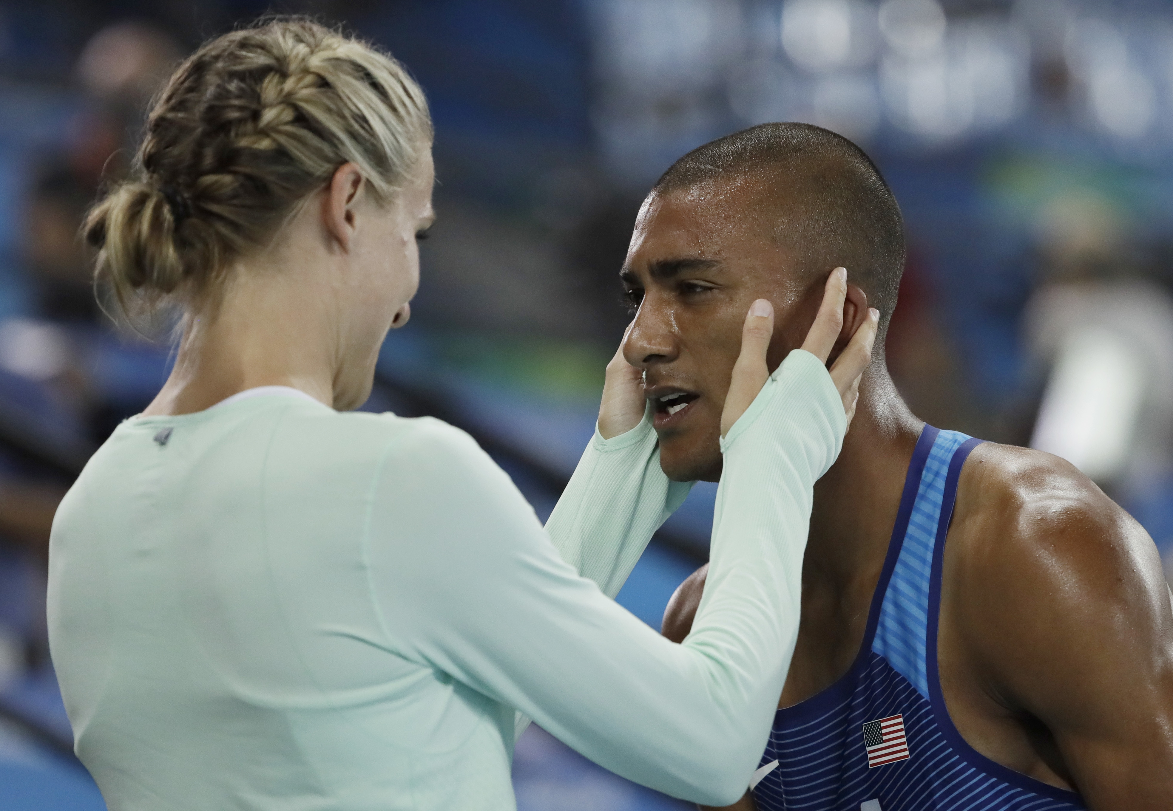 United States' Ashton Eaton embraces his wife Canada's Brianne Theisen Eaton after winning the gold medal in men's decathlon during the athletics competitions of the 2016 Summer Olympics at the Olympic stadium in Rio de Janeiro, Brazil, Thursday, Aug. 18,