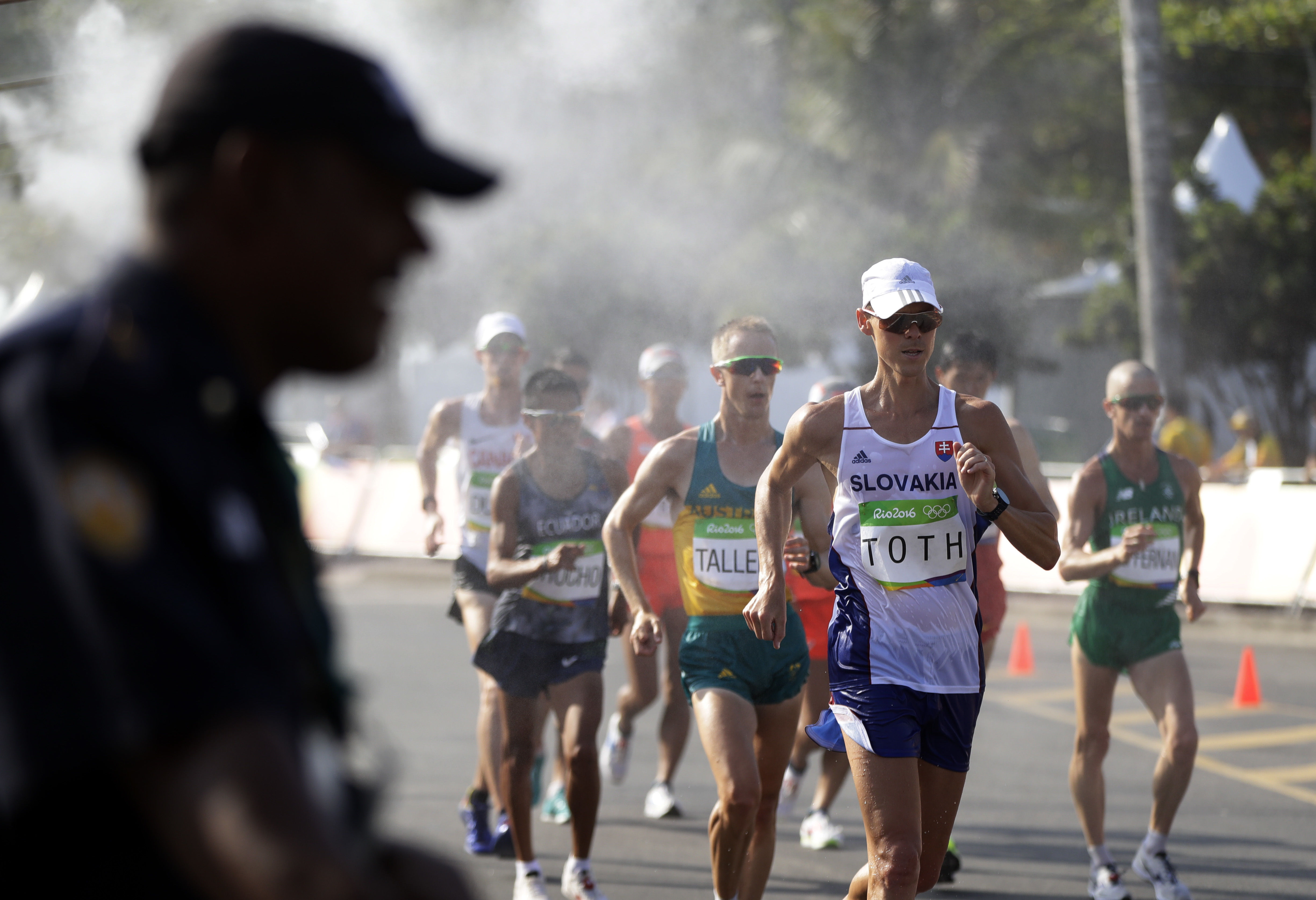 Competitors pass through a misting station during the men's 50-km race walk at the 2016 Summer Olympics in Rio de Janeiro, Brazil, Friday, Aug. 19, 2016. (AP Photo/Robert F. Bukaty)