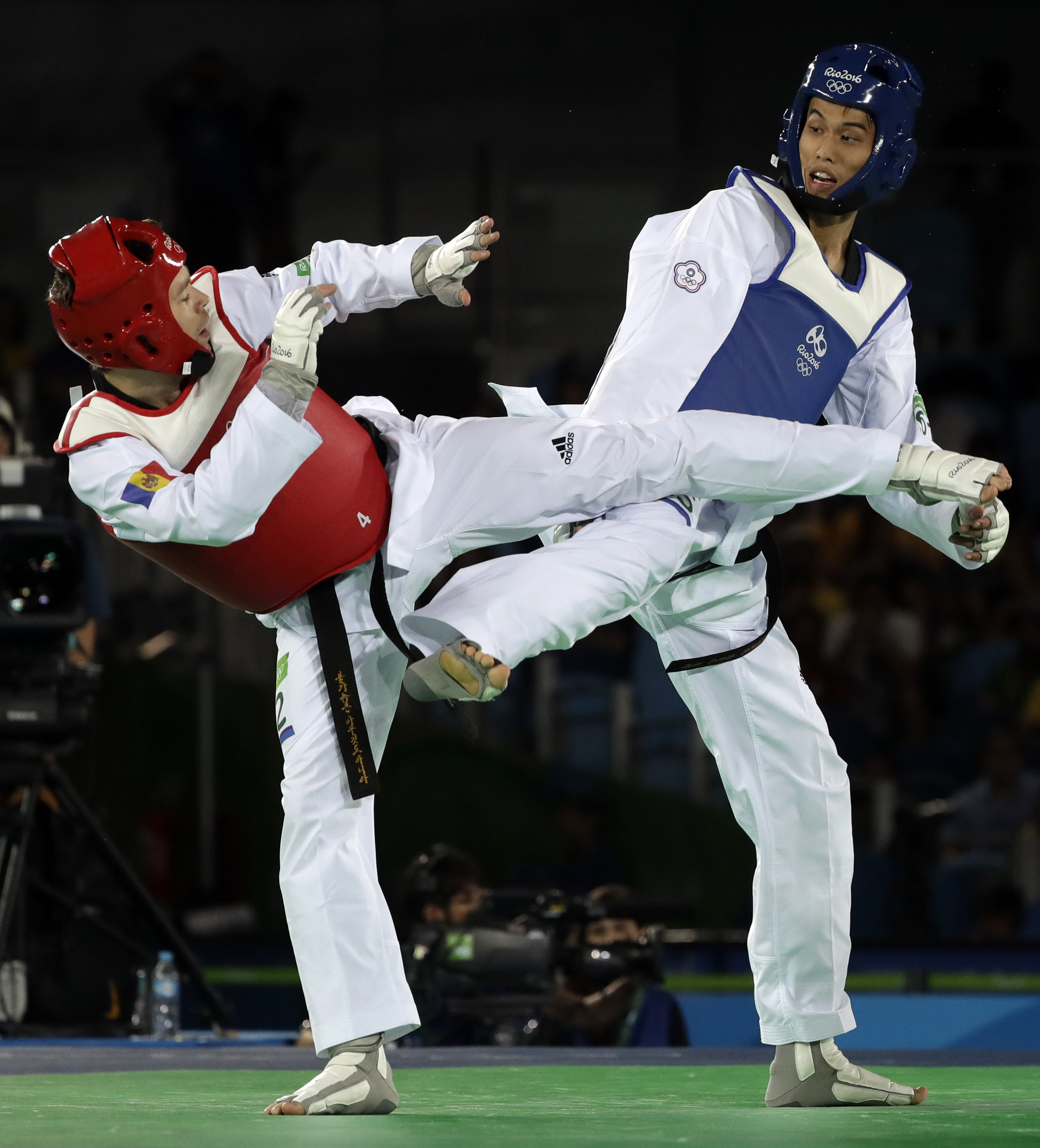 Liu Wei-Ting of Taipei, right, and Aaron Cook of Moldova compete in a men's Taekwondo 80-kg competition at the 2016 Summer Olympics in Rio de Janeiro, Brazil, Friday, Aug. 19, 2016. (AP Photo/Andrew Medichini)