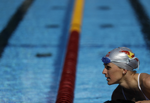 FILE - In this Aug. 17, 2016 file photo, Gwen Jorgensen, of the United States, trains for the upcoming women's triathlon at the Summer Olympics in Rio de Janeiro, Brazil. The biggest factor for triathlon's burgeoning appeal in the U.S., according to USA T