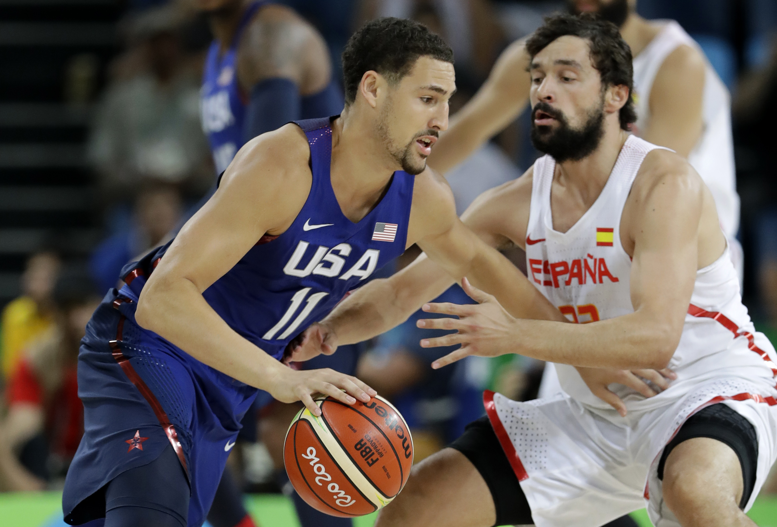 United States' Klay Thompson (11) drives past Spain's Sergio Llull, right, during a semifinal round basketball game at the 2016 Summer Olympics in Rio de Janeiro, Brazil, Friday, Aug. 19, 2016. (AP Photo/Charlie Neibergall)