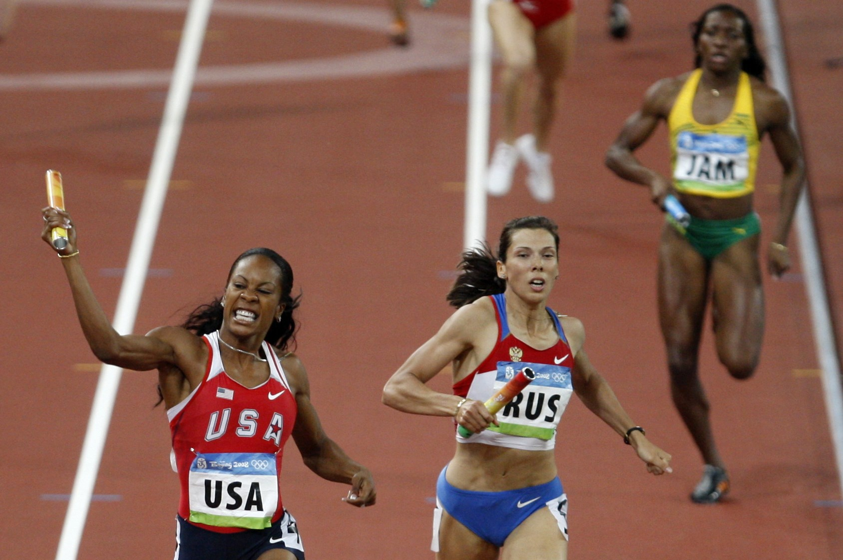 FILE - In this Aug. 23, 2008 file photo, United States' Sanya Richards, left, celebrates winning the women's 4x400-meter final at the Beijing 2008 Olympics in Beijing, China. At center is Russia's Anastasia Kapachinskaya, who took the silver, but in 2016