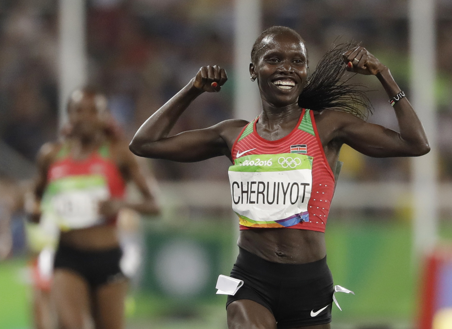 Kenya's Vivian Jepkemoi Cheruiyot celebrates winning the gold medal and setting a new Olympic record in the women's 5000-meter final during the athletics competitions of the 2016 Summer Olympics at the Olympic stadium in Rio de Janeiro, Brazil, Friday, Au