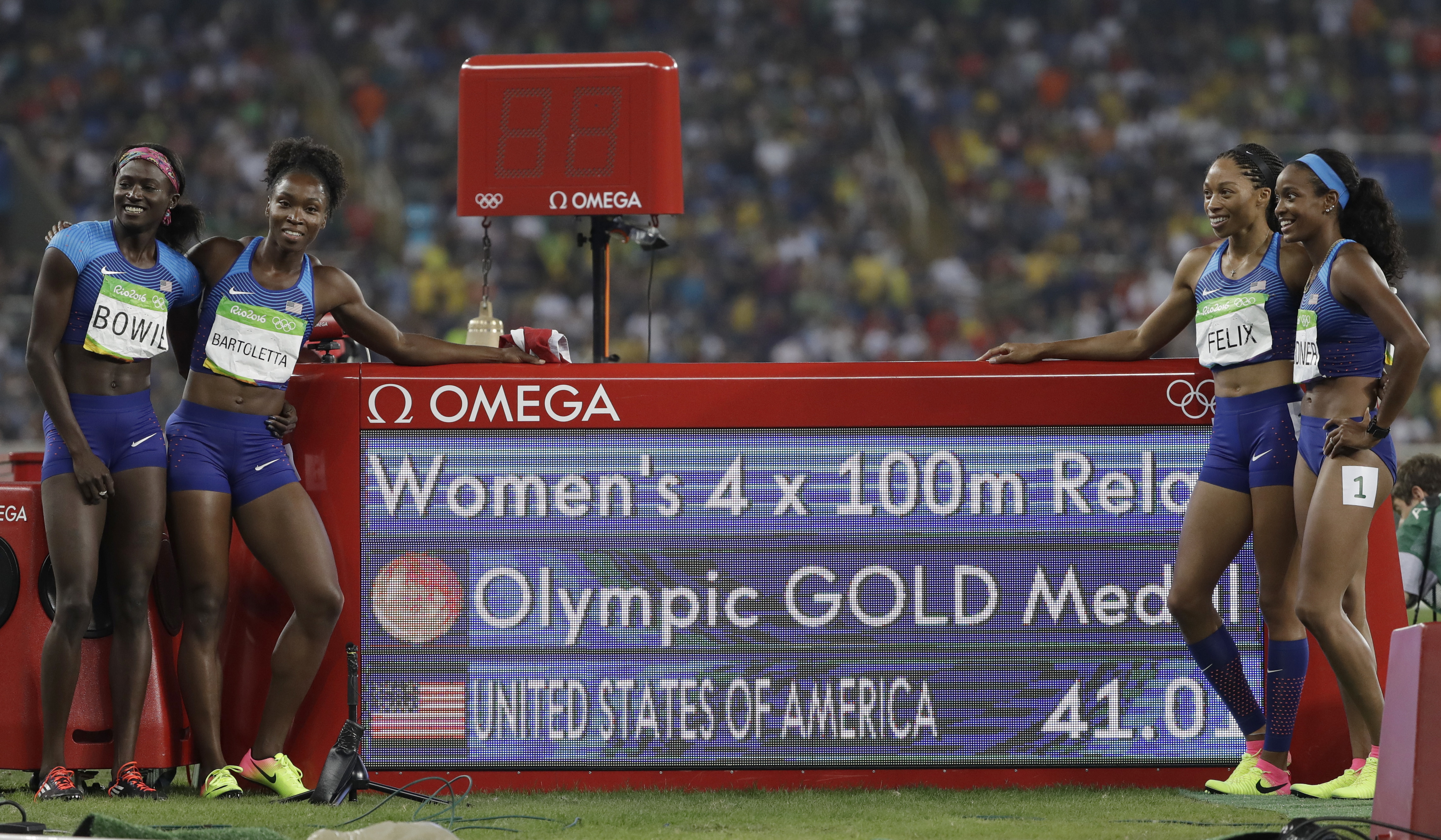 The United States team from left, Tori Bowie, Tianna Bartoletta, Allyson Felix and English Gardner celebrate winning the gold medal in the women's 4x100-meter relay final during the athletics competitions of the 2016 Summer Olympics at the Olympic stadium