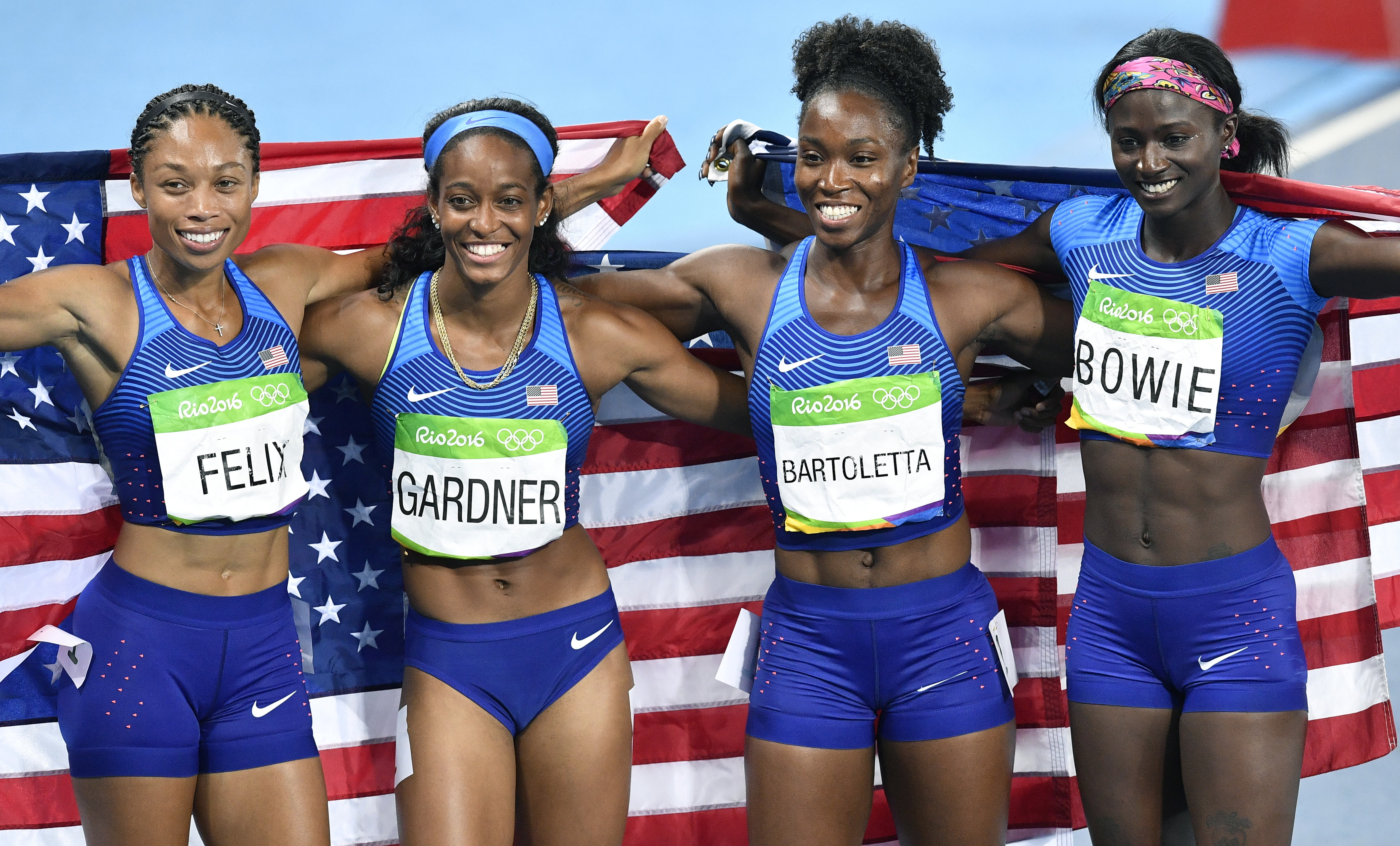 The United States team from left, Allyson Felix, English Gardner, Tianna Bartoletta and Tori Bowie celebrate winning the gold medal in the women's 4x100-meter relay final during the athletics competitions of the 2016 Summer Olympics at the Olympic stadium