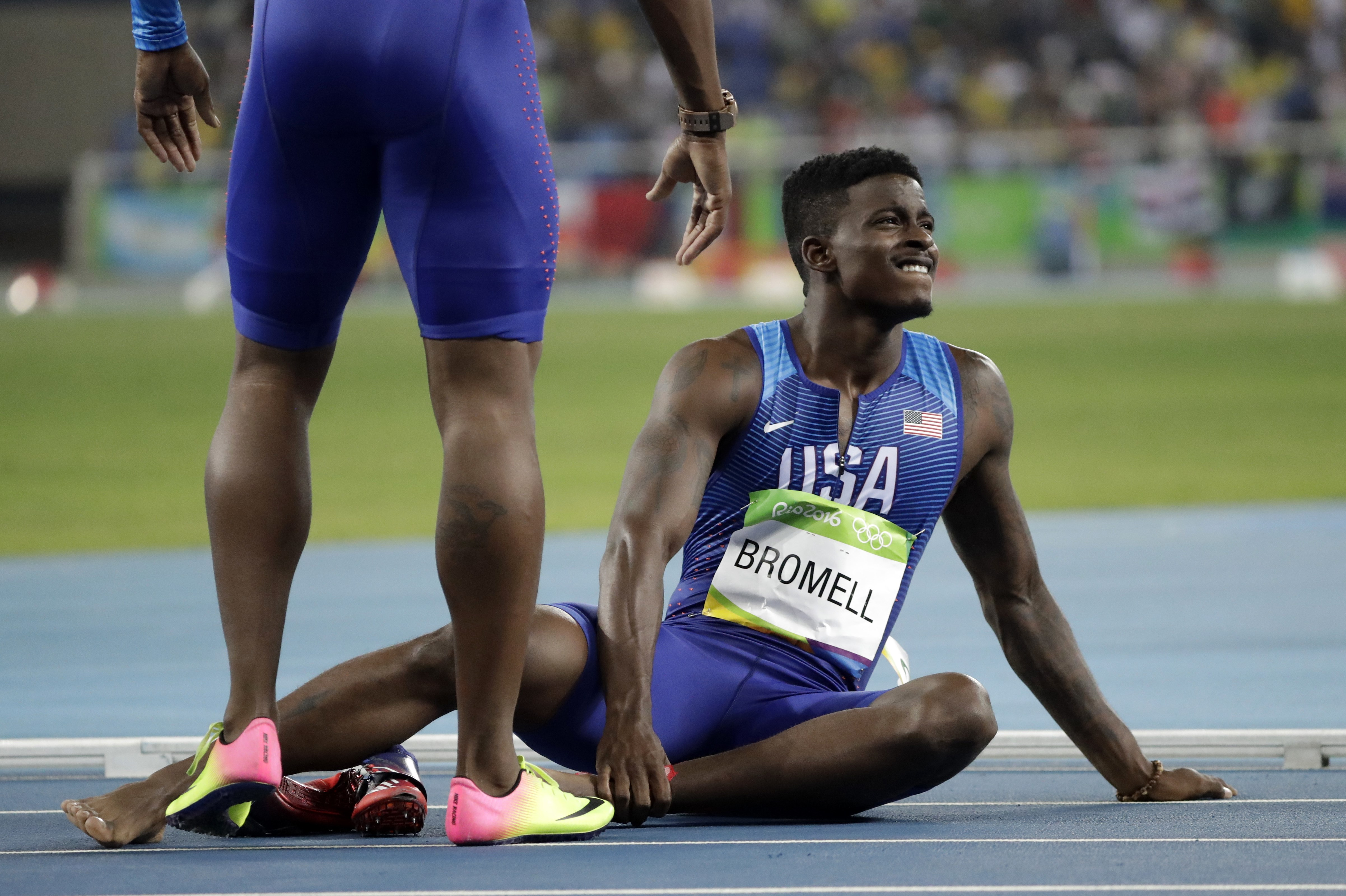United States' Trayvon Bromell sits on the track after falling in the men's 4x100-meter relay final during the athletics competitions of the 2016 Summer Olympics at the Olympic stadium in Rio de Janeiro, Brazil, Friday, Aug. 19, 2016. (AP Photo/David J. P