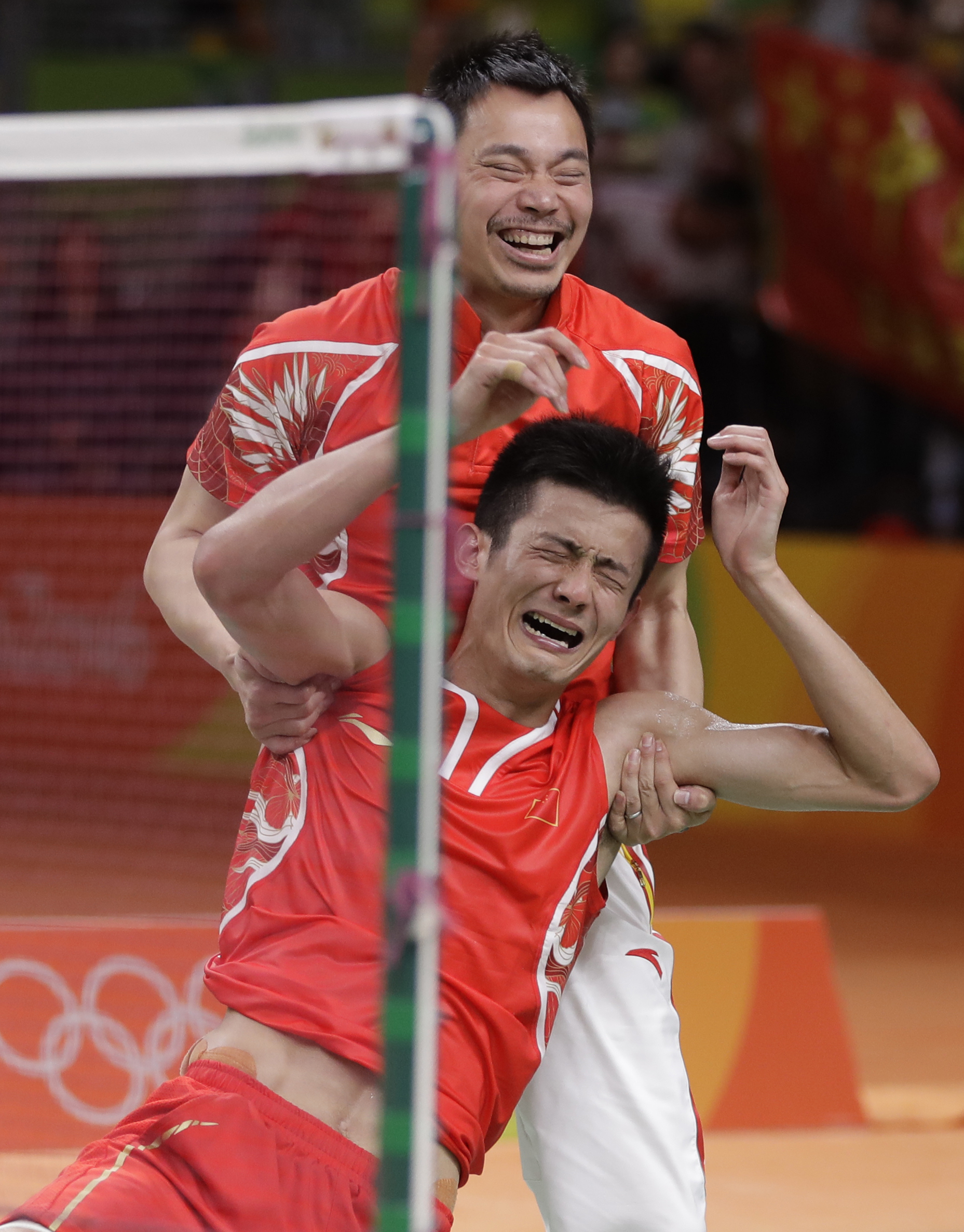 China's Chen Long celebrates after winning his men's badminton singles final match against Malaysia's Lee Chong Wei, at the 2016 Summer Olympics in Rio de Janeiro, Brazil, Saturday, Aug. 20, 2016. (AP Photo/Kin Cheung)