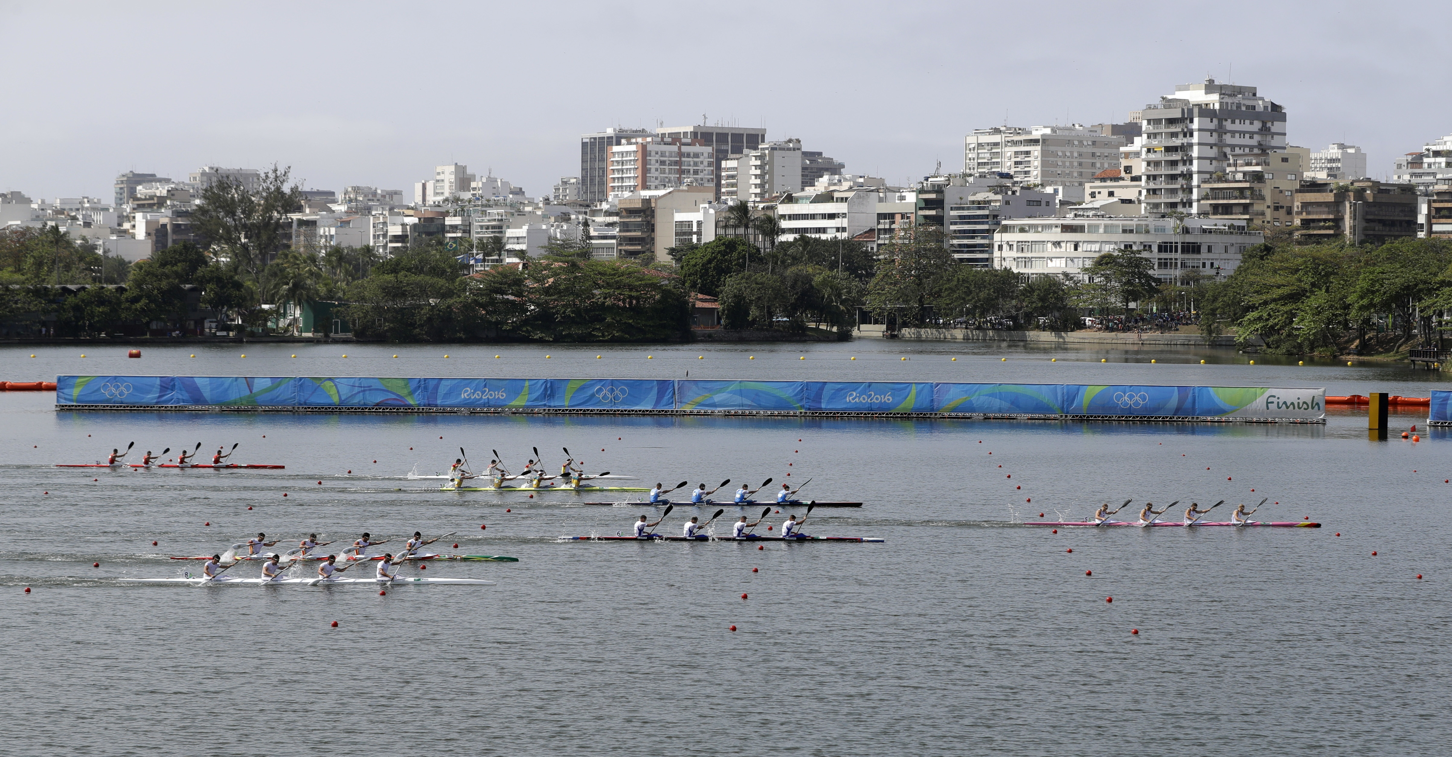 Germany's Max Rendschmidt, Tom Liebscher, Max Hoff and Marcus Gross, far right, paddle for gold in the men's kayak four 1000m final during the 2016 Summer Olympics in Rio de Janeiro, Brazil, Saturday, Aug. 20, 2016. (AP Photo/Darron Cummings)