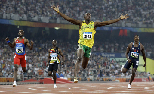 FILE - In this Aug. 20, 2008 file photo, Jamaica's Usain Bolt crosses the finish line to win the gold in the men's 200-meter final during the athletics competitions in the National Stadium at the Beijing 2008 Olympics in Beijing. (AP Photo/Anja Niedringha