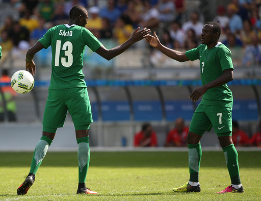 Nigeria's Sadiq Umar, left, celebrates scoring his side's 3rd goal with his teammate Umar Aminu during the bronze medal match of the men's Olympic football tournament between Honduras and Nigeria at Mineirao stadium in Belo Horizonte, Brazil, Saturday Aug