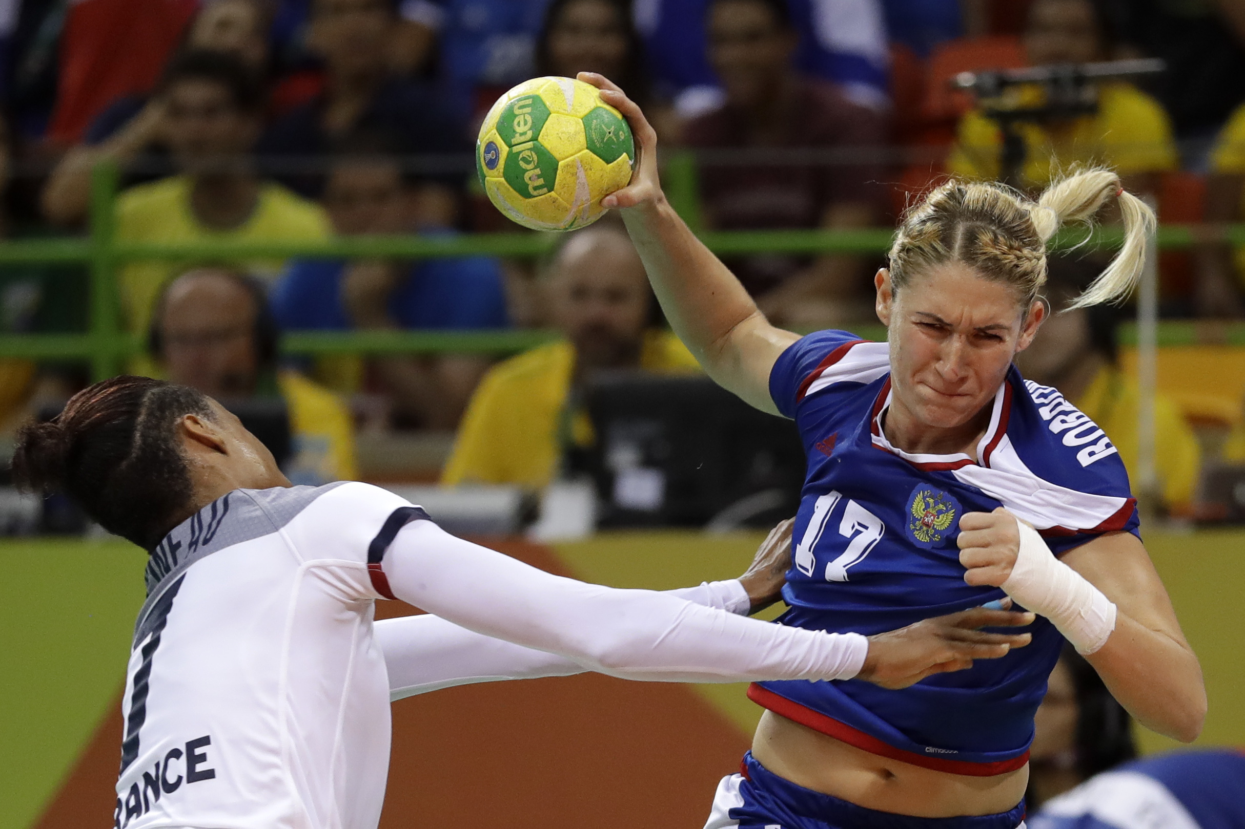 Russia's Vladlena Bobrovnikova, right, and France's Allison Pineau challenge for the ball during the women's final handball match between France and Russia at the 2016 Summer Olympics in Rio de Janeiro, Brazil, Saturday, Aug. 20, 2016. (AP Photo/Matthias