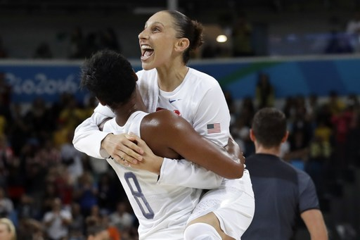 United States' Diana Taurasi, right, leaps into the arms of teammate Angel McCoughtry as they celebrate their win over Spain in a women's gold medal basketball game at the 2016 Summer Olympics in Rio de Janeiro, Brazil, Saturday, Aug. 20, 2016. (AP Photo/