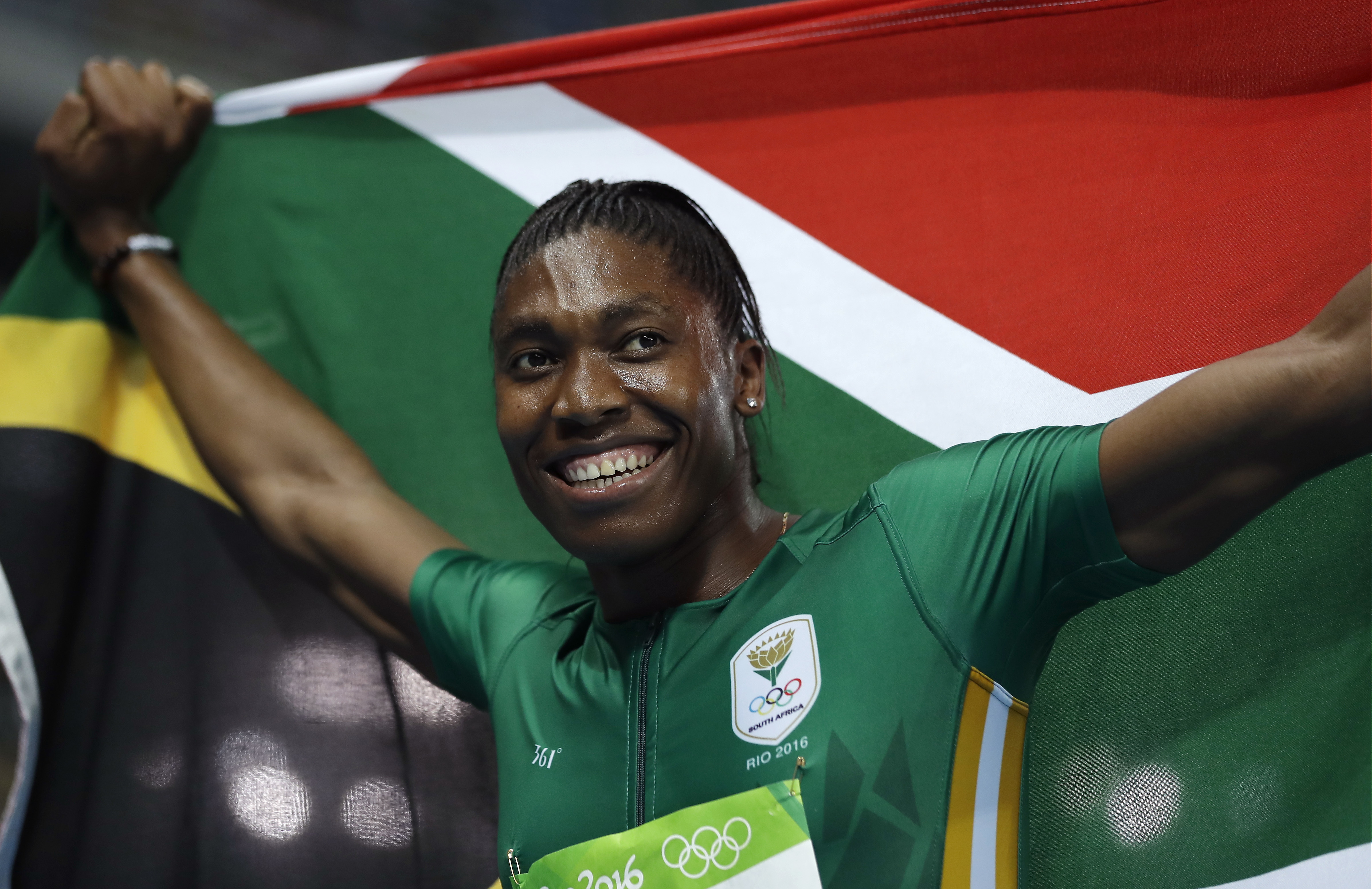 South Africa's Caster Semenya smiles after winning the gold medal in the women's 800-meter final during the athletics competitions of the 2016 Summer Olympics at the Olympic stadium in Rio de Janeiro, Brazil, Saturday, Aug. 20, 2016. (AP Photo/Matt Slocum