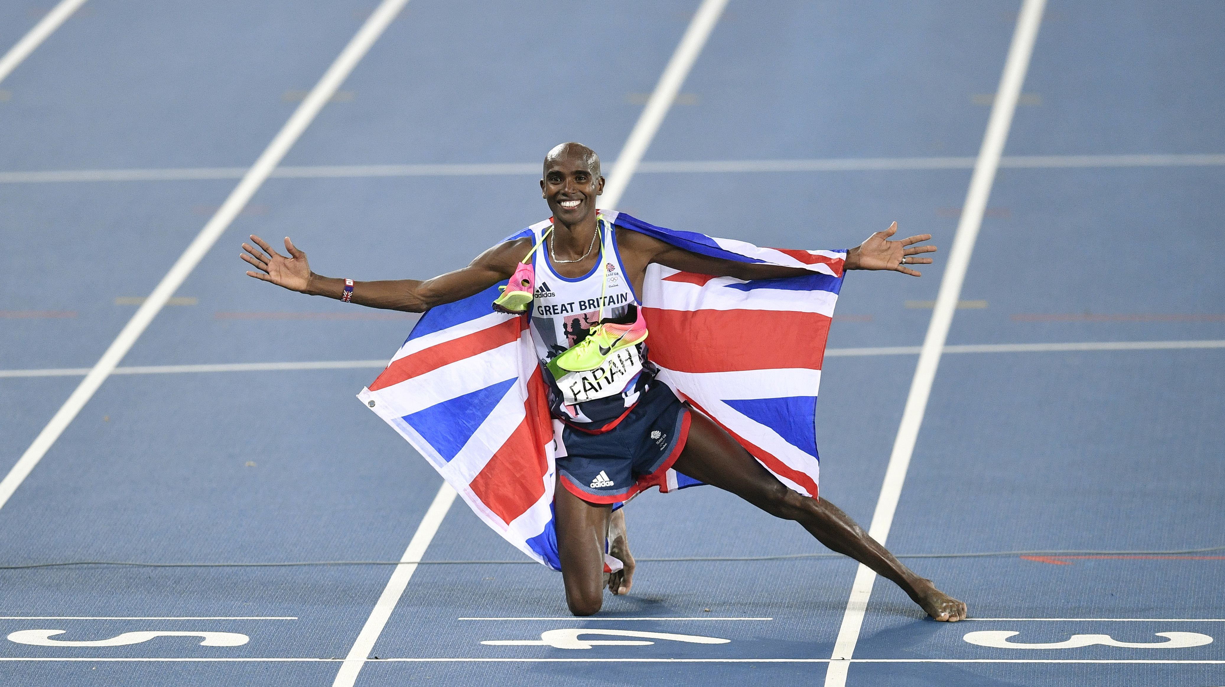 Britain's Mo Farah celebrates winning the gold medal in the men's 5000-meter final during the athletics competitions of the 2016 Summer Olympics at the Olympic stadium in Rio de Janeiro, Brazil, Saturday, Aug. 20, 2016. (AP Photo/Martin Meissner)