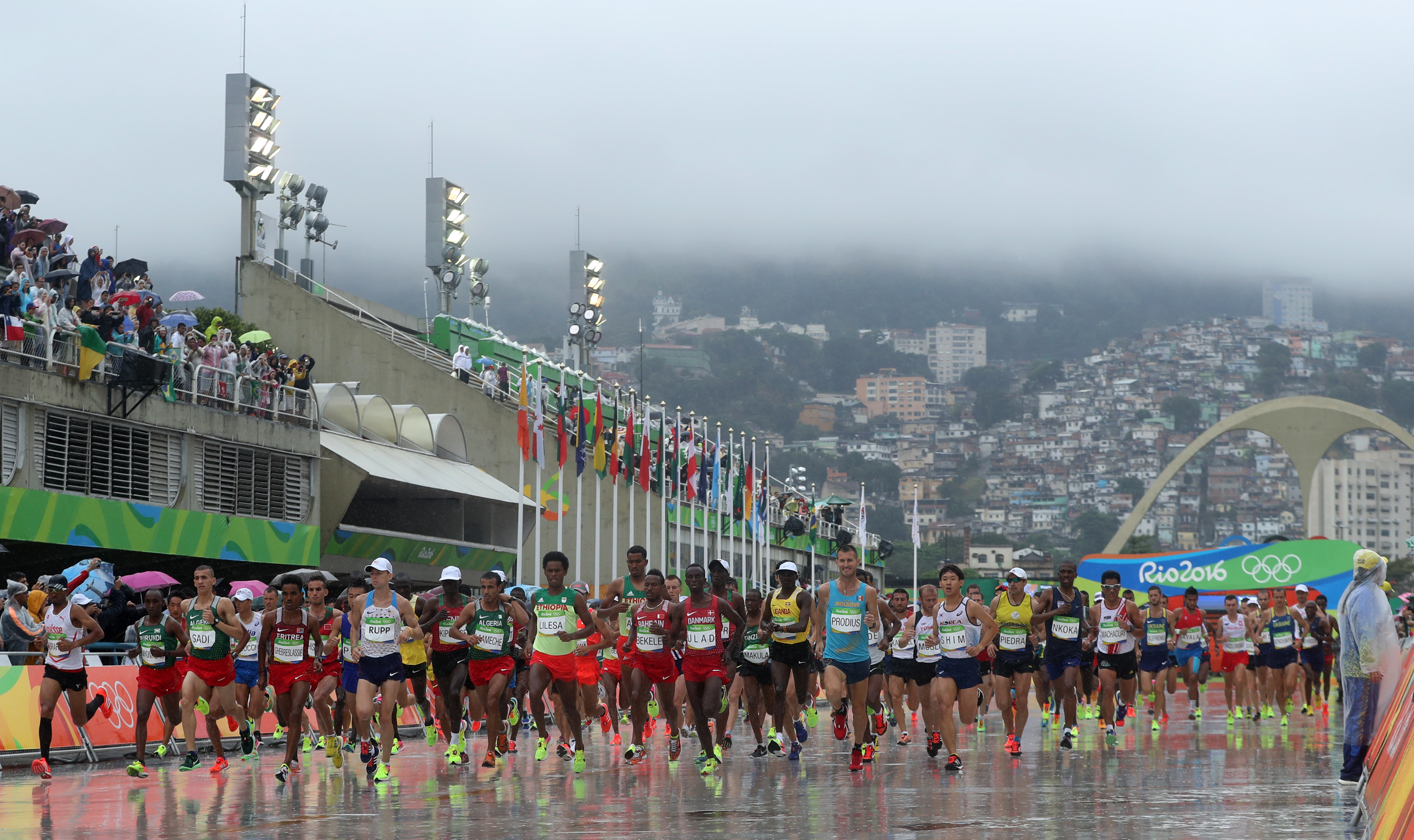 Athletes start to the men's marathon at the 2016 Summer Olympics in Rio de Janeiro, Brazil, Sunday, Aug. 21, 2016. (AP Photo/Petr David Josek)