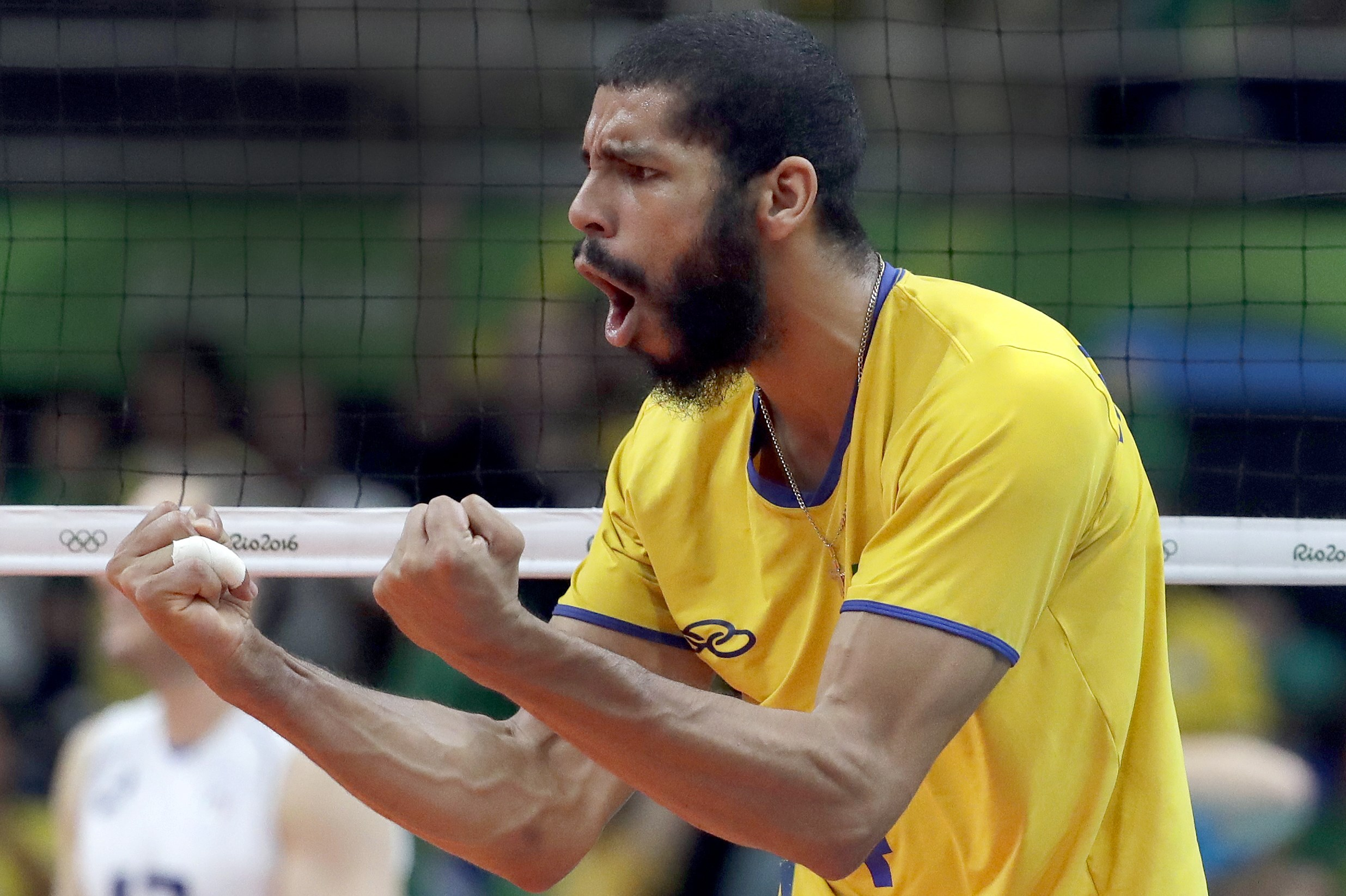 Brazil's Wallace de Souza celebrates during a men's gold medal volleyball match against Italy at the 2016 Summer Olympics in Rio de Janeiro, Brazil, Sunday, Aug. 21, 2016. (AP Photo/Jeff Roberson)