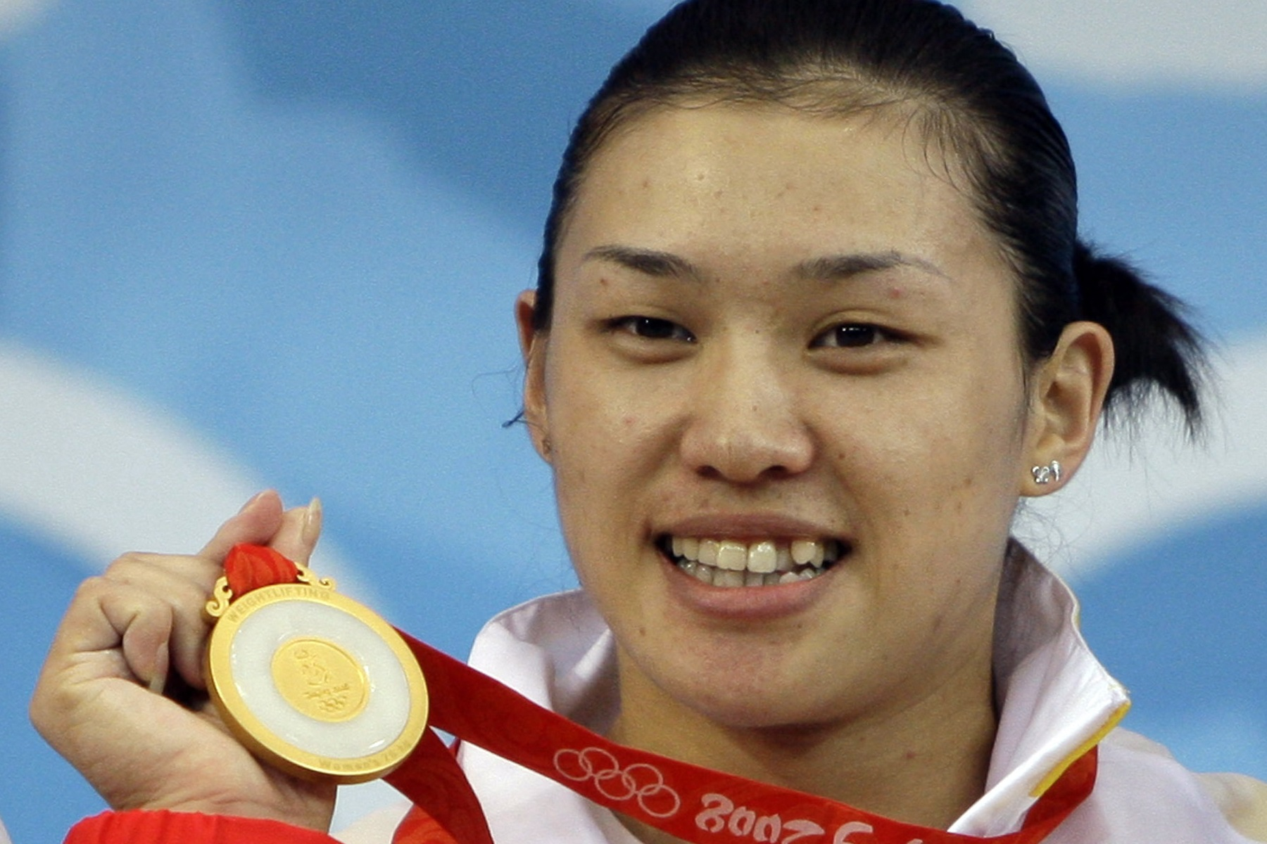 Cao Lei, of China, holds up her gold medal in the women's 75 kg of the weightlifting competition at the Beijing 2008 Olympics in Beijing, Friday, Aug. 15, 2008. Cao set new Olympic records in the snatch (128 kg), clean and jerk (154 kg) and the overall (2