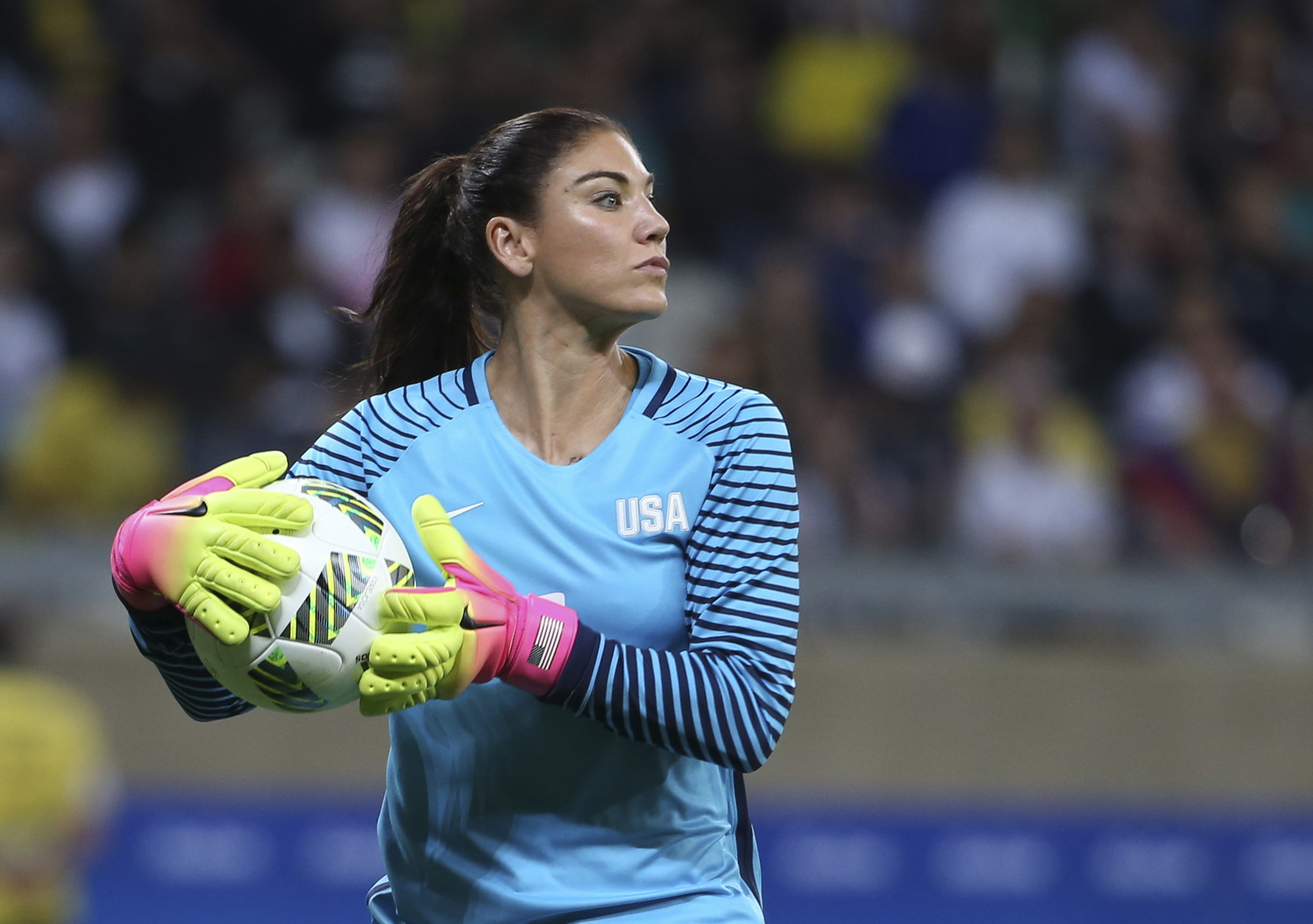 FILE - In this Aug. 3, 2016, file photo, U.S. goalkeeper Hope Solo takes the ball during a women's Olympic football tournament match against New Zealand in Belo Horizonte, Brazil. Solo has been suspended form the team for six months for what U.S. Soccer t