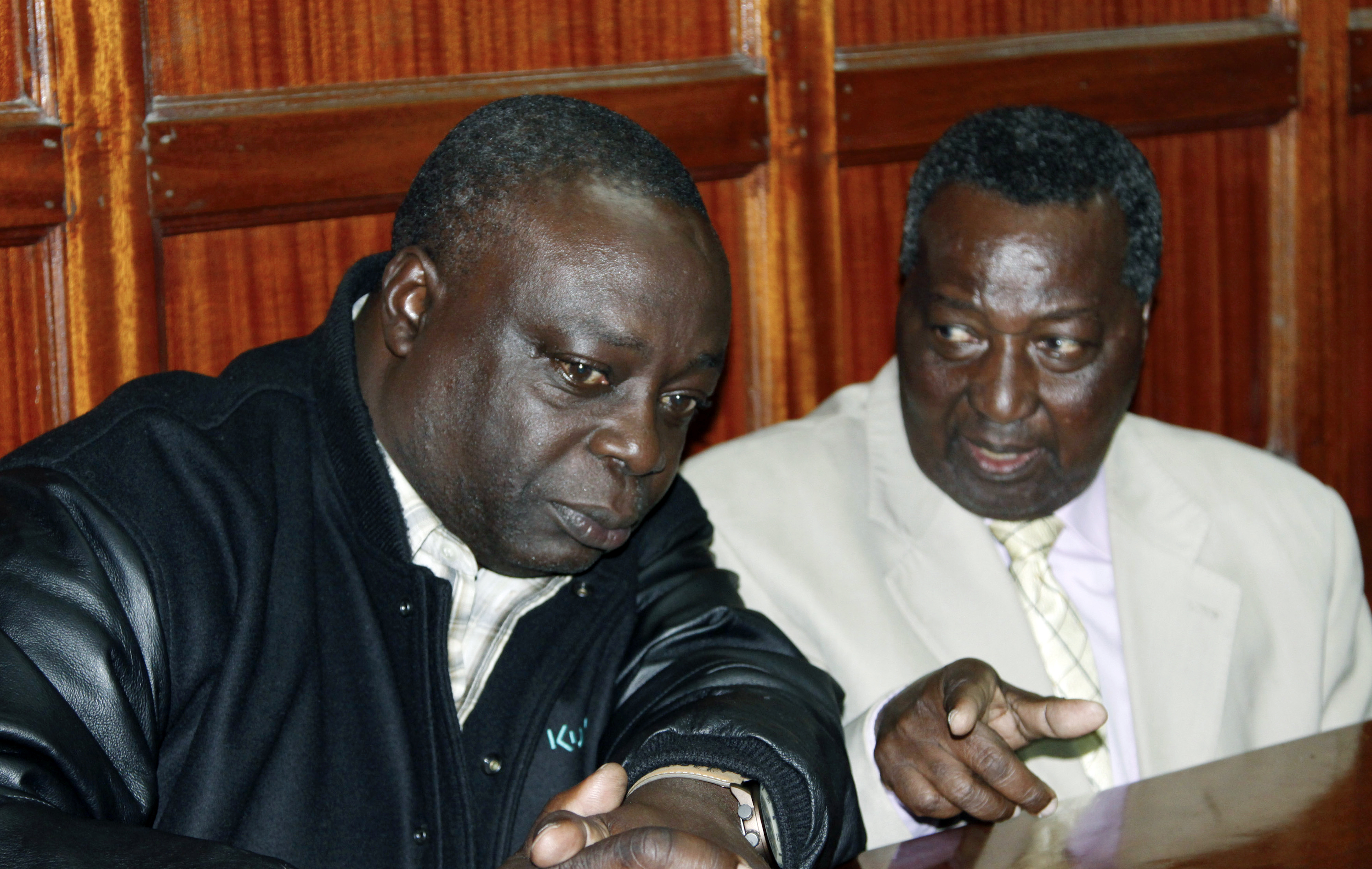 National Olympic Committee of Kenya secretary general Francis K Paul, left, and vice-chairman Pius Ochieng, right, appear at the High Court in Nairobi, Kenya, Monday, Aug. 29, 2016, following their arrest last week on their return from Brazil. Three senio