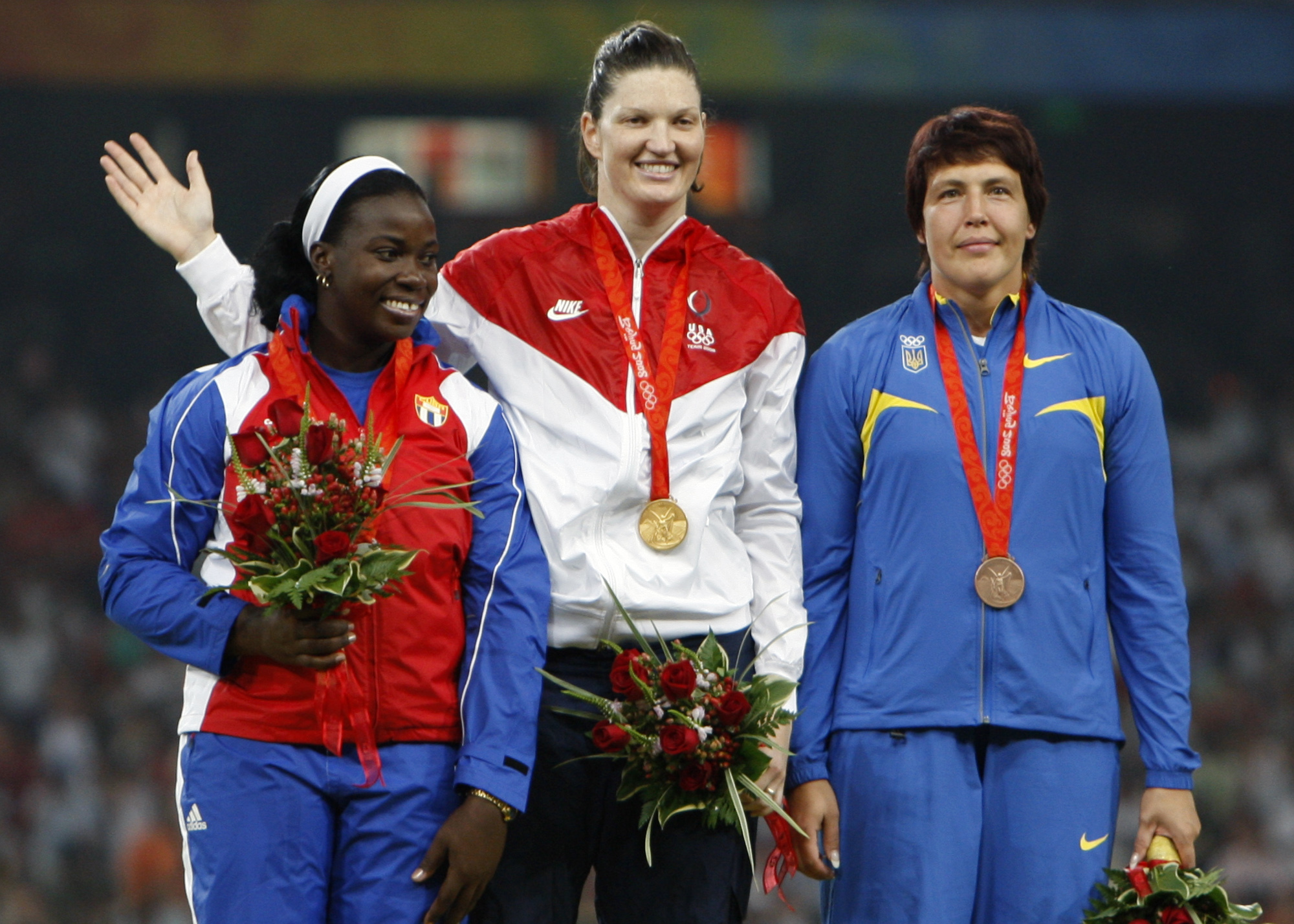 FILE- In this Monday, Aug. 18, 2008 file photo, silver winner Yarelys Barrios of Cuba, left, poses on the podium with gold medalist Stephanie Brown Trafton of the U.S, center, and bronze winner Olena Antonova of Ukraine during the awarding ceremony for th