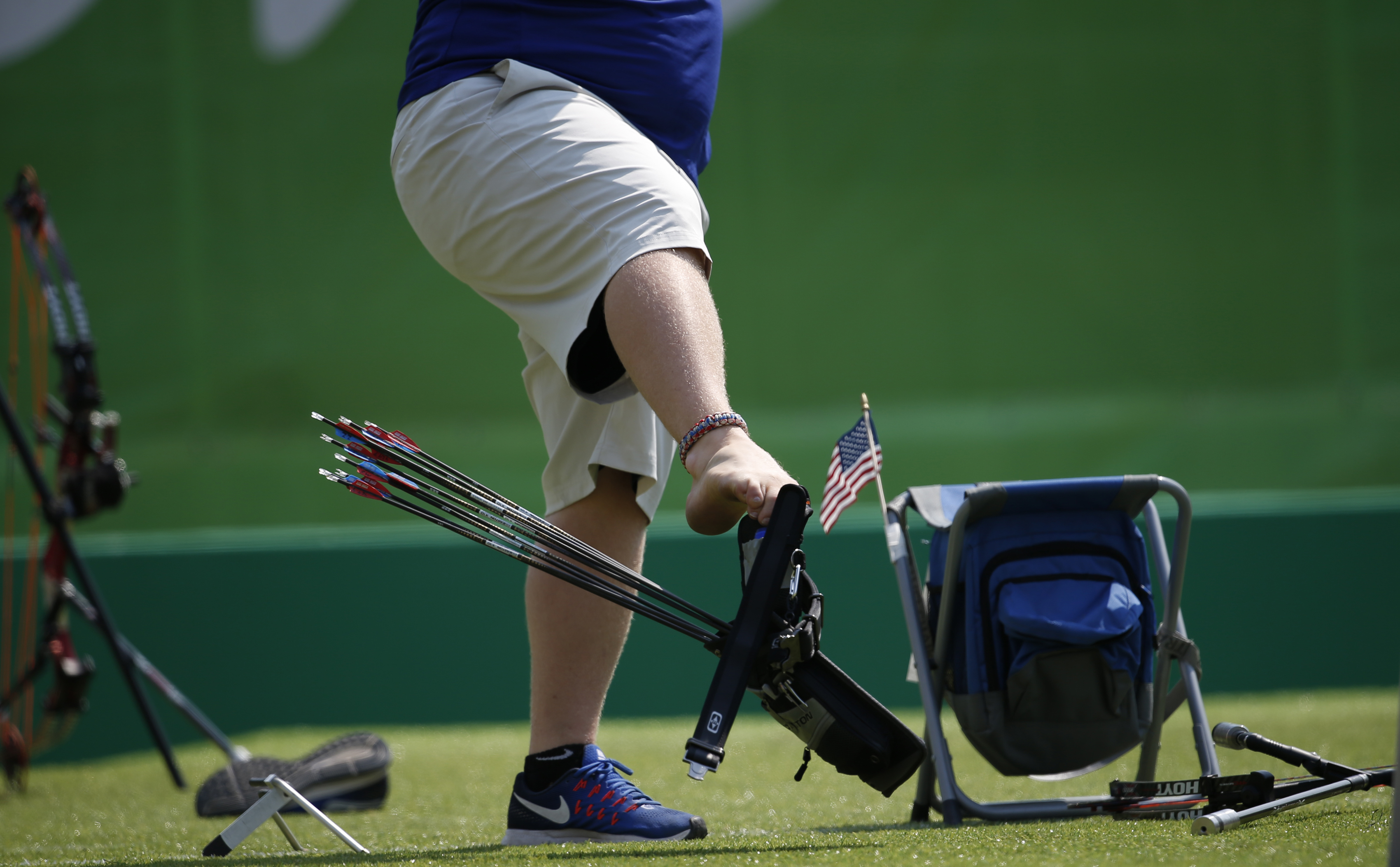 Matt Stutzman, of United States, holds the bow with his foot as he competes in the individual compound-open, during the Paralympic Games at the Sambadrome, in Rio de Janeiro, Brazil, Wednesday, Sept. 14, 2016.  Stutzman, known widely as the Armless Archer