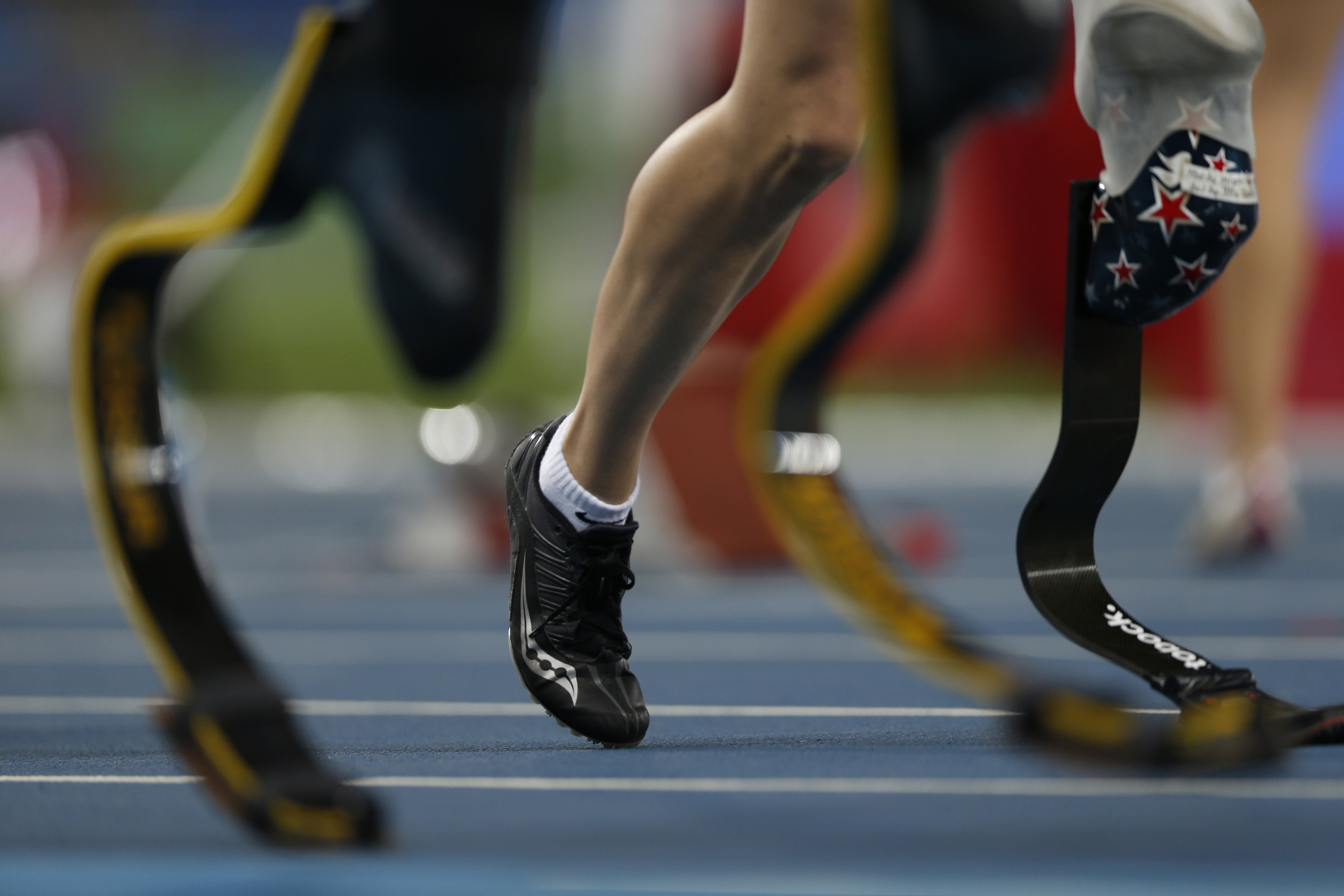 In this Monday, Sept. 12, 2016 photo, athletes compete in the women's 400-meter T44 final athletics event of the Paralympic Games in Rio de Janeiro, Brazil. The games needed a bailout from Brazil's government of almost $80 million to make it to the starti