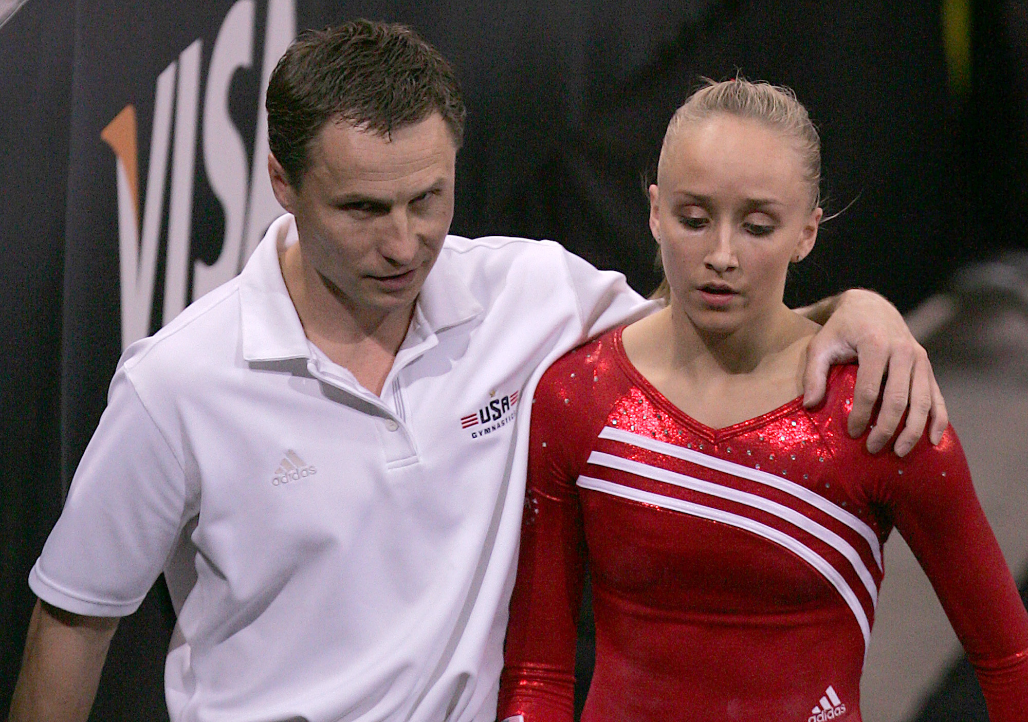 FILE - In this March 29, 2008 file photo Nastia Liukin, right, of the United States, is spoken to by her father and coach Valeri Liukin after she performed on the uneven bars at the Pacific Rim Gymnastics Championships in San Jose, Calif. USA Gymnastics d