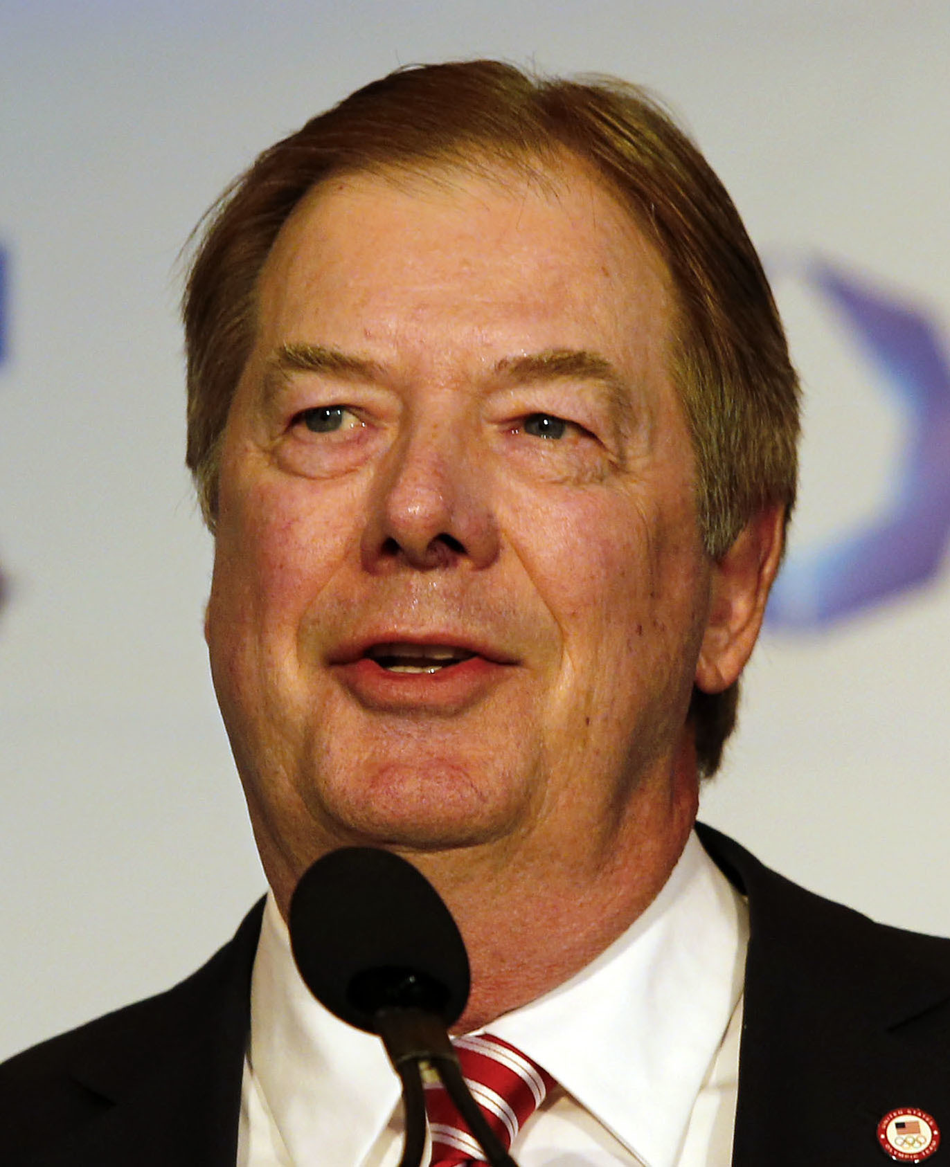 File- This Jan. 9, 2015, file photo shows USOC Chairman of the Board Larry Probst speaking during a news conference in Boston. The leader of the U.S. Olympic Committee reiterated his support for allowing some Russians to compete at the Rio Games and said