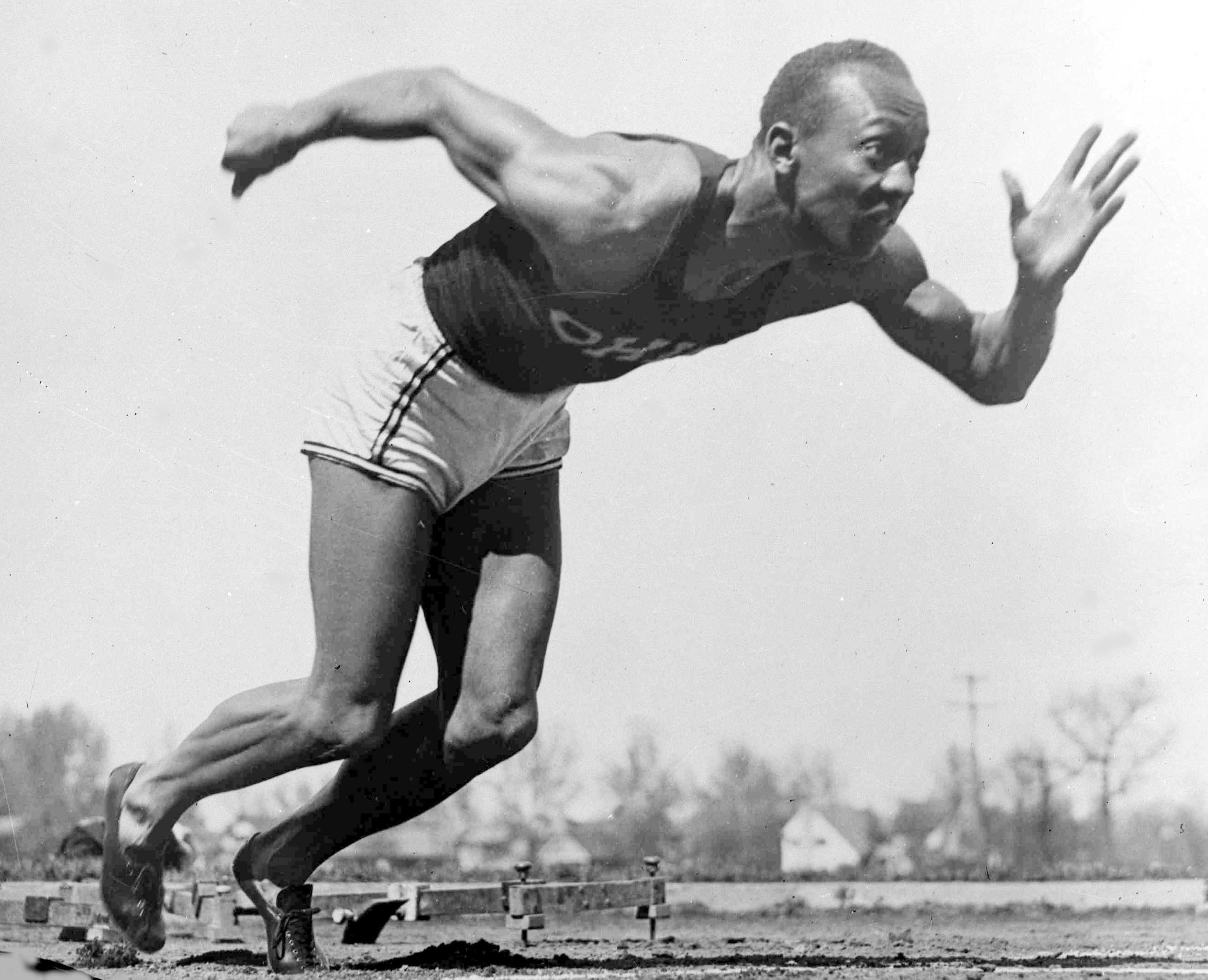 File - In this Aug. 5, 1936 file photo, American athlete Jesse Owens practices in the Olympic Village in Berlin. Shortly after Jesse Owens returned home from his snubbing by Adolph Hitler at the 1936 Olympics, he and America's 17 other black Olympians fou