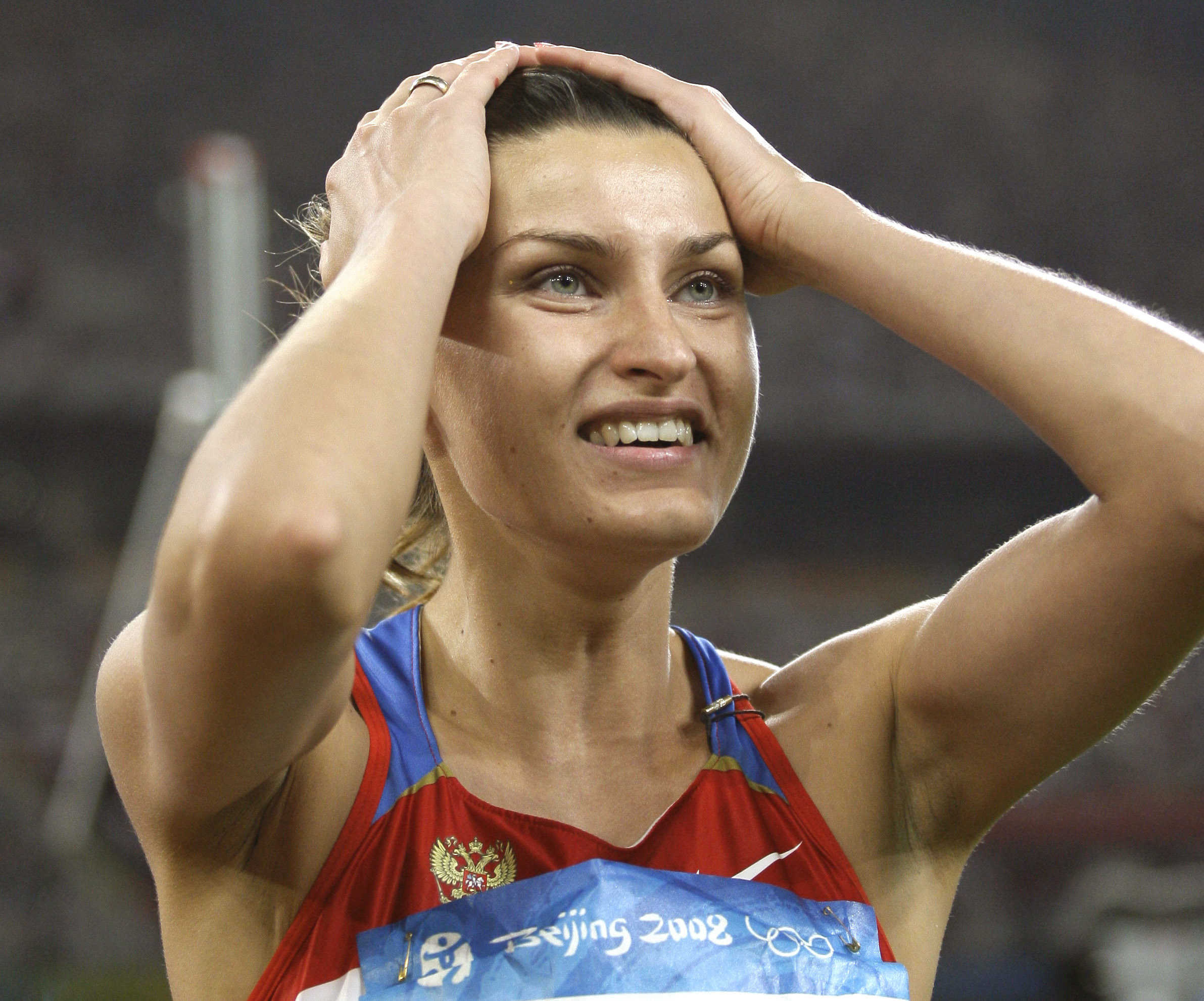 FILE - In this Aug. 23, 2008 file photo Russia's Anna Chicherova reacts after making a clearance in the final of the women's high jump during the athletics competitions in the National Stadium at the Beijing 2008 Olympics in Beijing. On Thursday, Oct. 6,