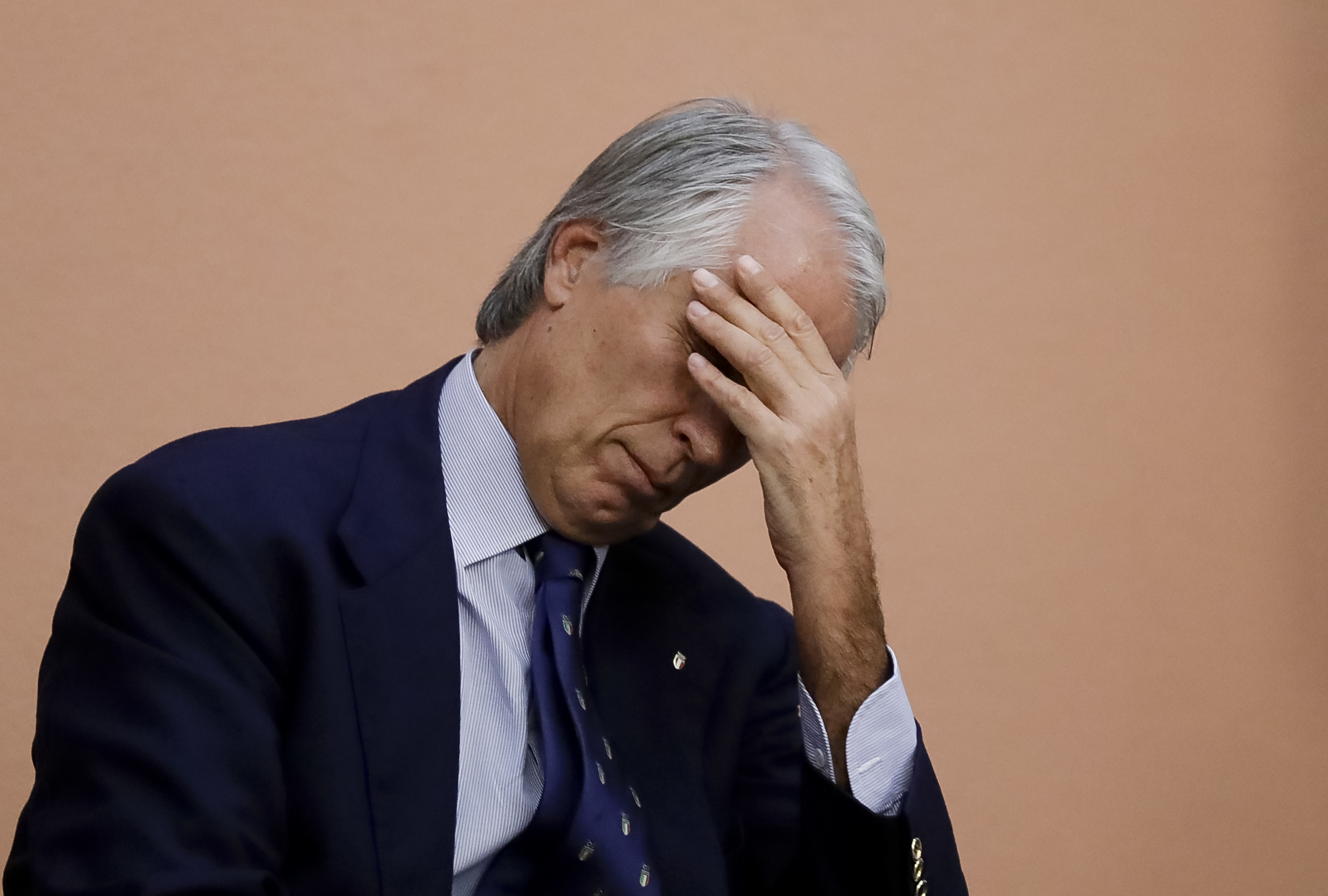 Italian Olympic Committee President Giovanni Malago' touches his forehead during a press conference in Rome,  Tuesday, Oct. 11, 2016. The Italian Olympic Committee is suspending Rome's bid for the 2024 Games for the time being, while leaving open the poss
