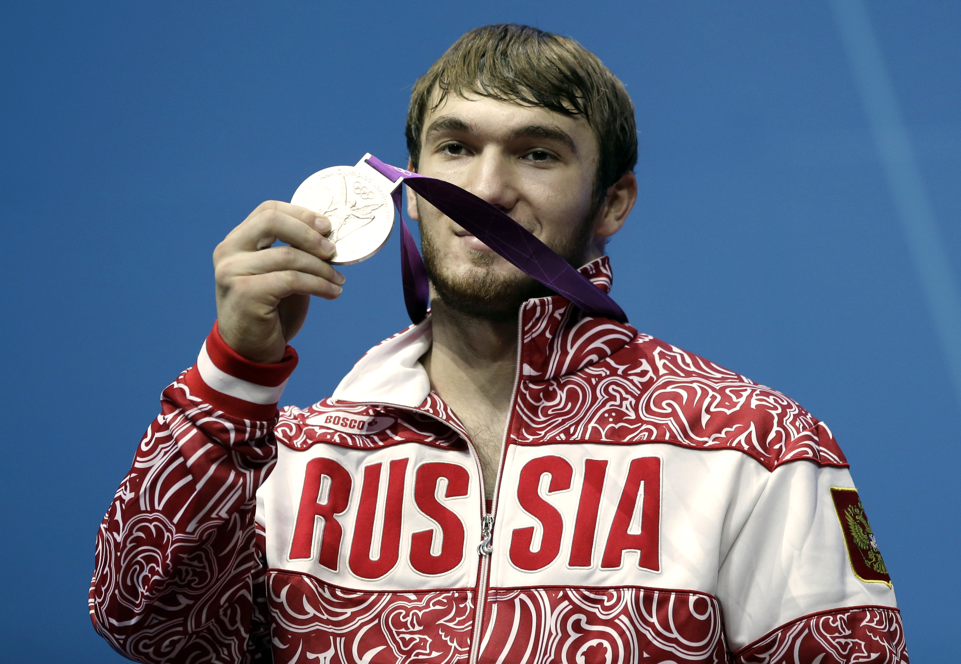 FILE - In this Friday, Aug. 3, 2012 file photo, silver medalist Apti Aukhadov of Russia shows off his medal during a ceremony after the men's 85-kg, group A, weightlifting competition at the 2012 Summer Olympics in London. Russian weightlifter Apti Aukhad