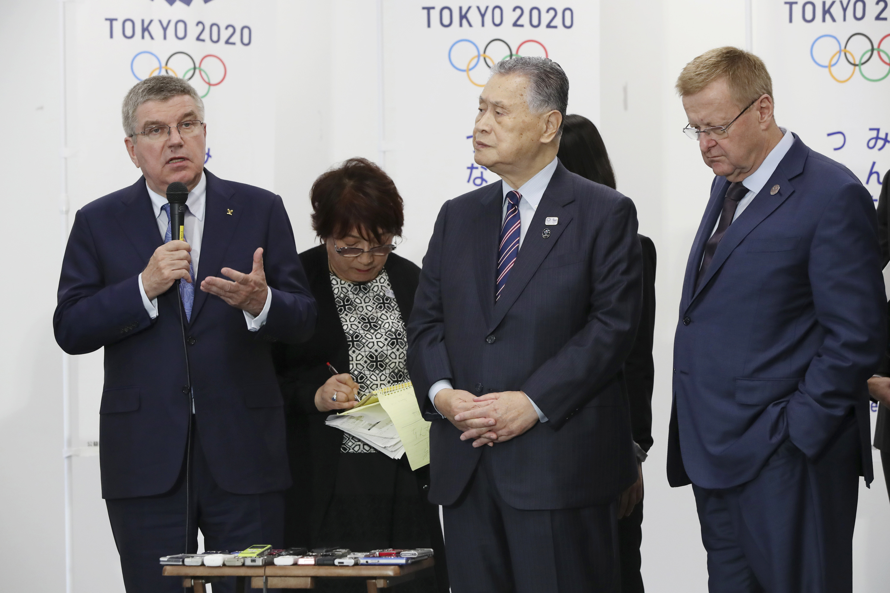 International Olympic Committee President Thomas Bach, left, flanked by Tokyo 2020 Olympic Organising Committee President Yoshiro Mori, center, and IOC Vice President John Coates, right, speaks during a meeting with board members of the Tokyo Organising C