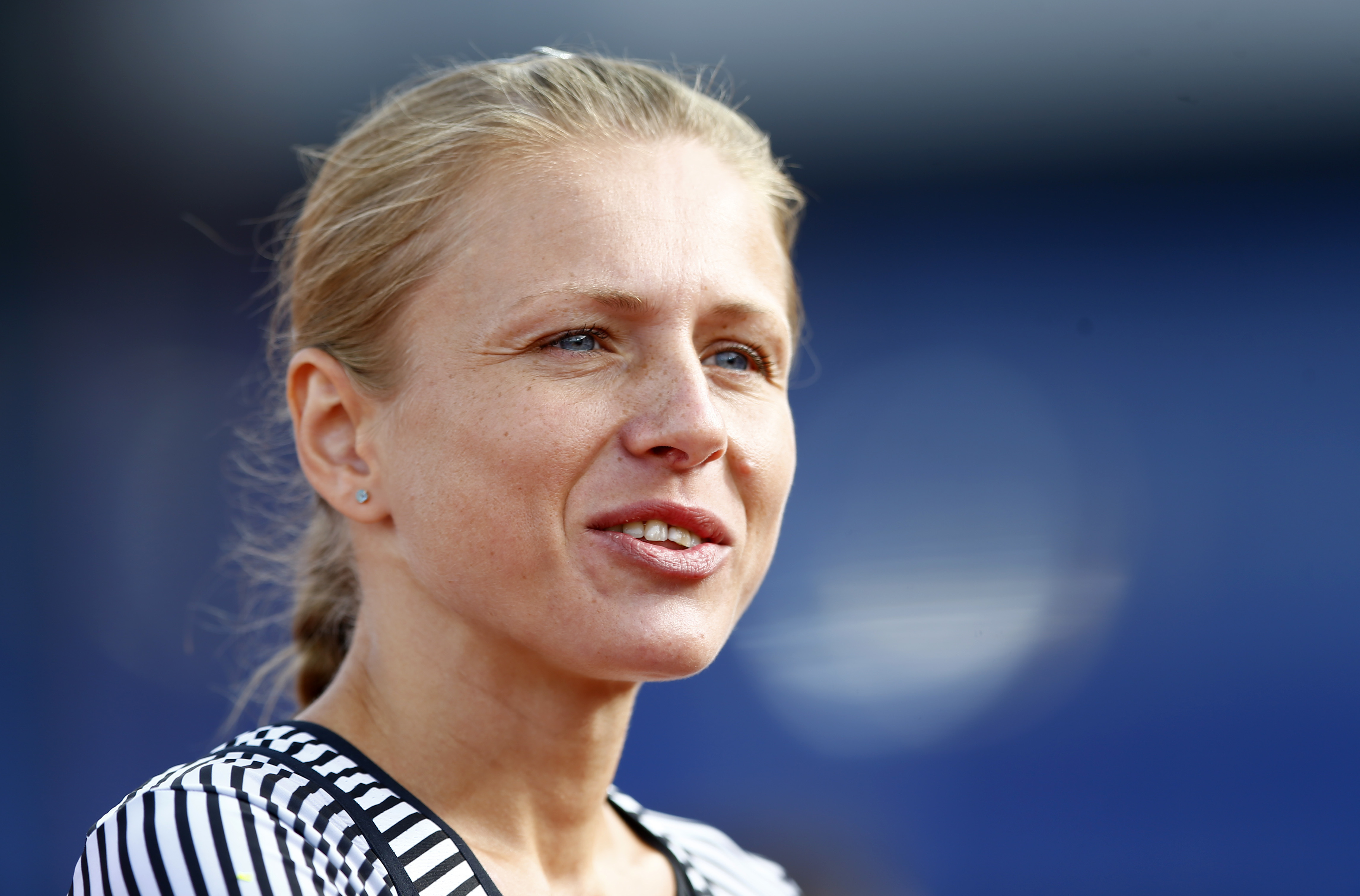 FILE - This is a Wednesday, July 6, 2016 file photo of Russian doping whistleblower Yulia Stepanova who ran under a neutral flag smiles as she arrives in the stadium to compete in a women's 800m heat during the European Athletics Championships in Amsterda