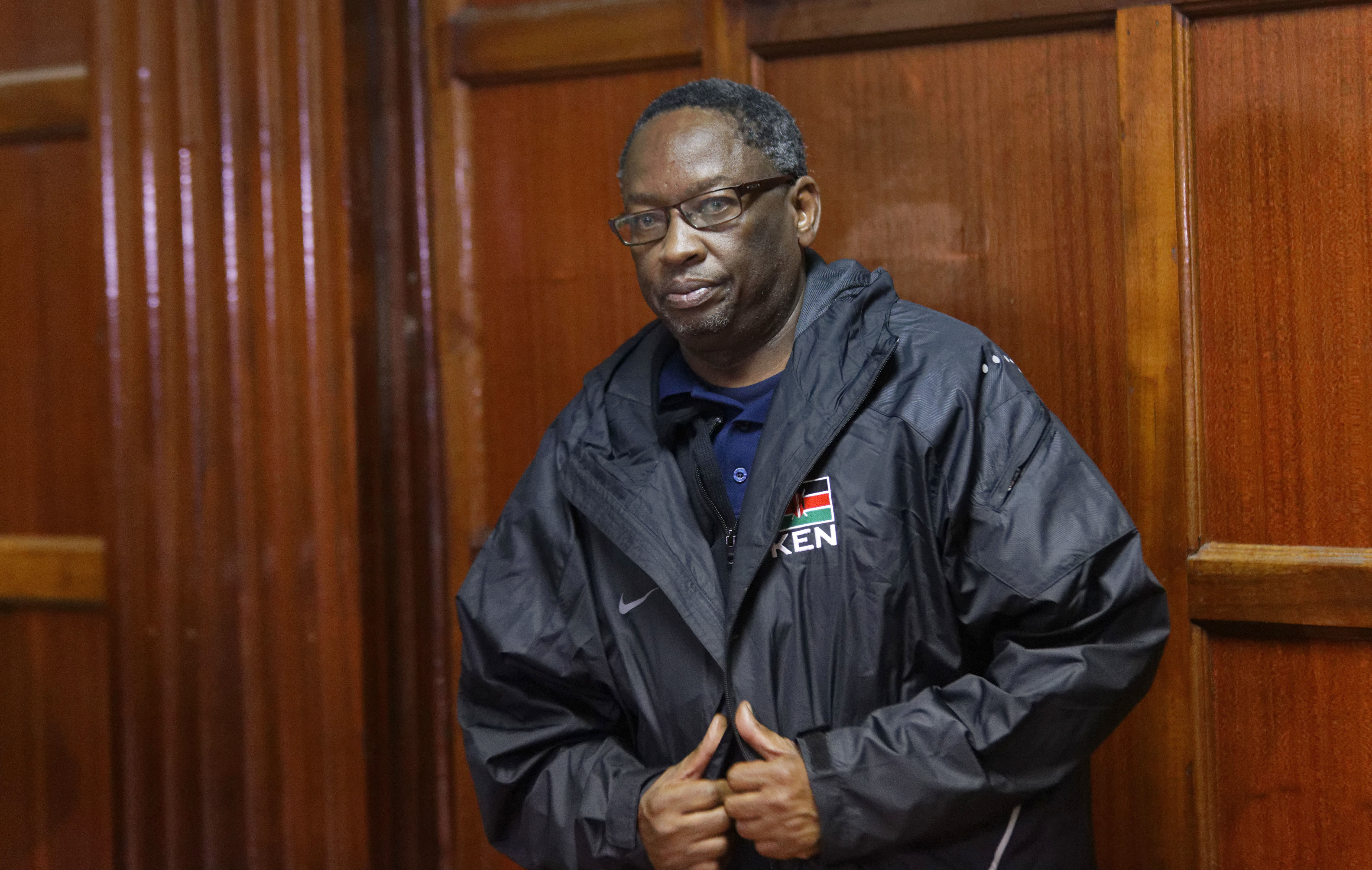 National Olympic Committee of Kenya vice president Ben Ekumbo, who is also head of the country's swimming federation, appears in the dock at the Milimani Law Court in Nairobi, Kenya Tuesday, Nov. 22, 2016. Ekumbo, the fifth senior Olympic committee offici