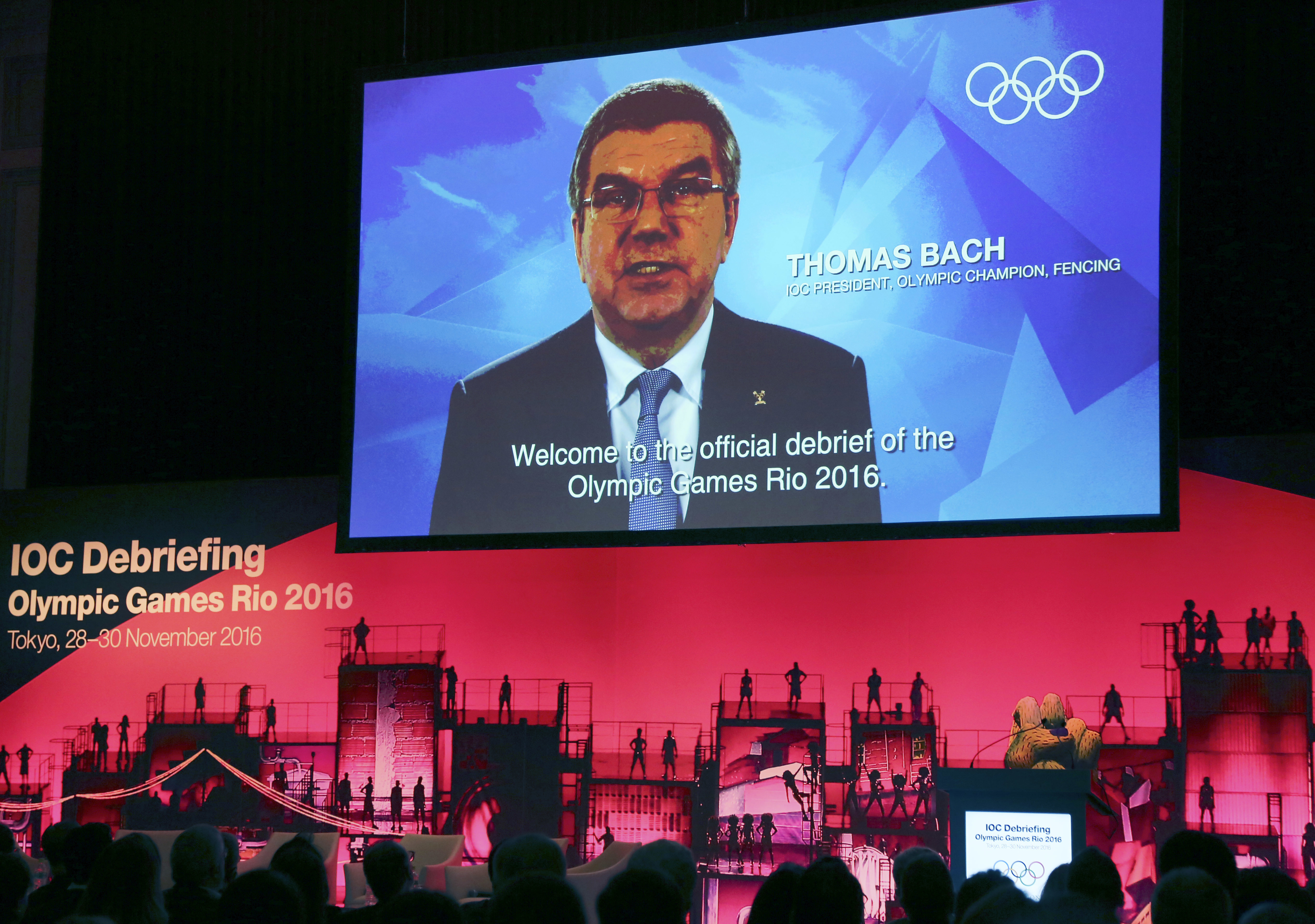 A huge screen shows International Olympic Committee President Thomas Bach's video message during the opening plenary session of the IOC Debriefing of the Olympic Games Rio 2016 in Tokyo, Monday, Nov. 28, 2016. The three-day IOC debriefing started Monday t