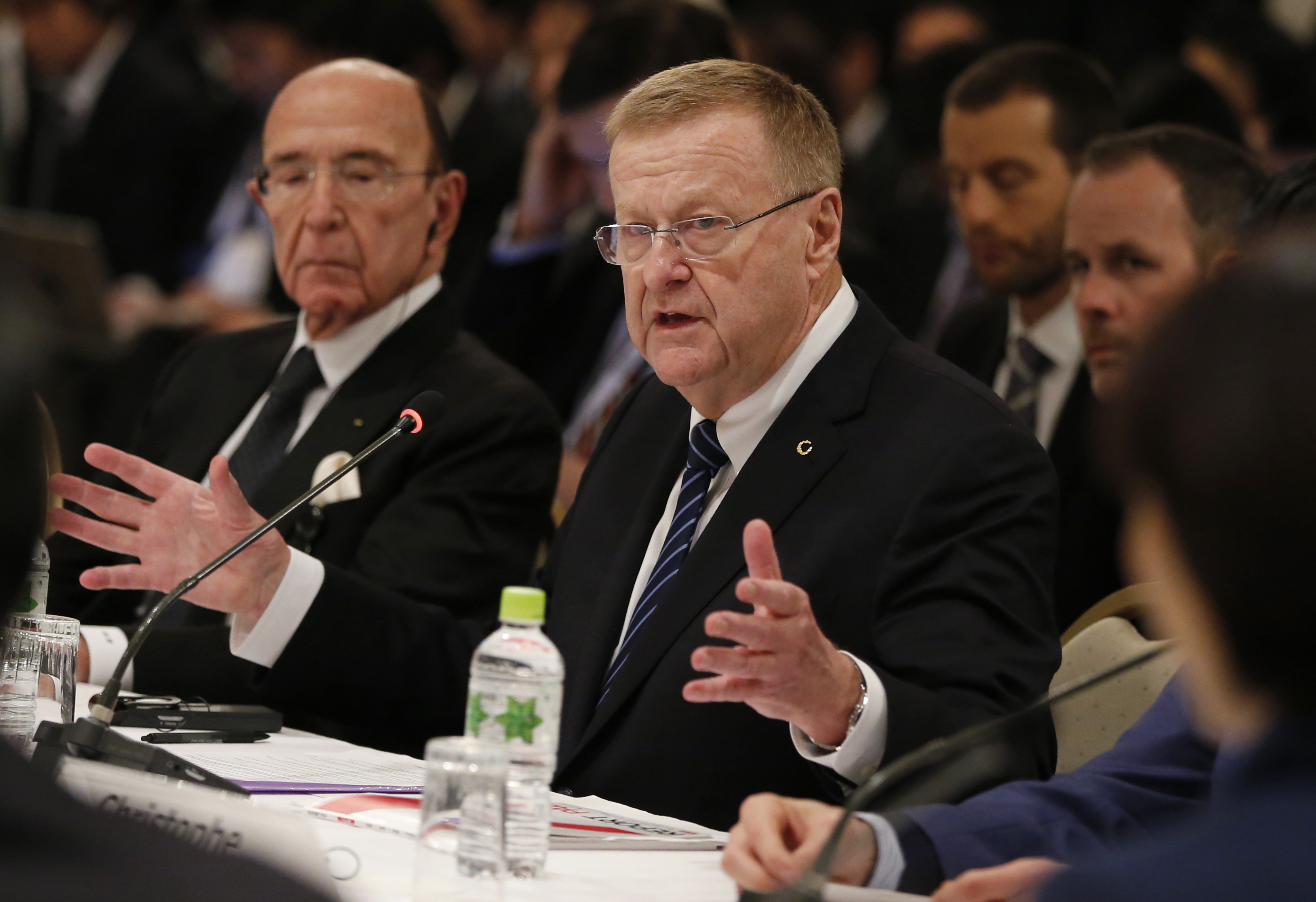 IOC Vice President John Coates, center, speaks at the IOC debriefing meeting in Tokyo, Tuesday, Nov. 29, 2016. Olympic officials have agreed to keep the rowing and swimming venues at their planned sites in Tokyo for the 2020 Games. A decision on the volle