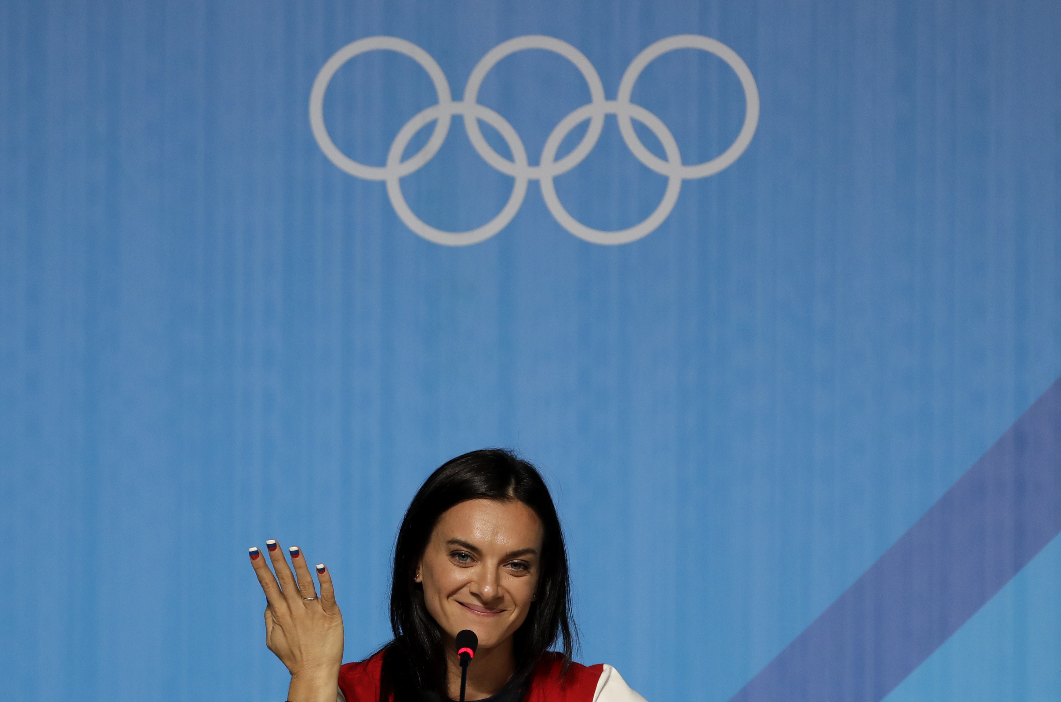 FILE_- In this Friday, Aug. 19, 2016 file photo, Yelena Isinbayeva, Russia's pole vault world record holder, speaks during a news conference at the 2016 Summer Olympics in Rio de Janeiro, Brazil.  Former Olympic pole vault champion Yelena Isinbayeva has b