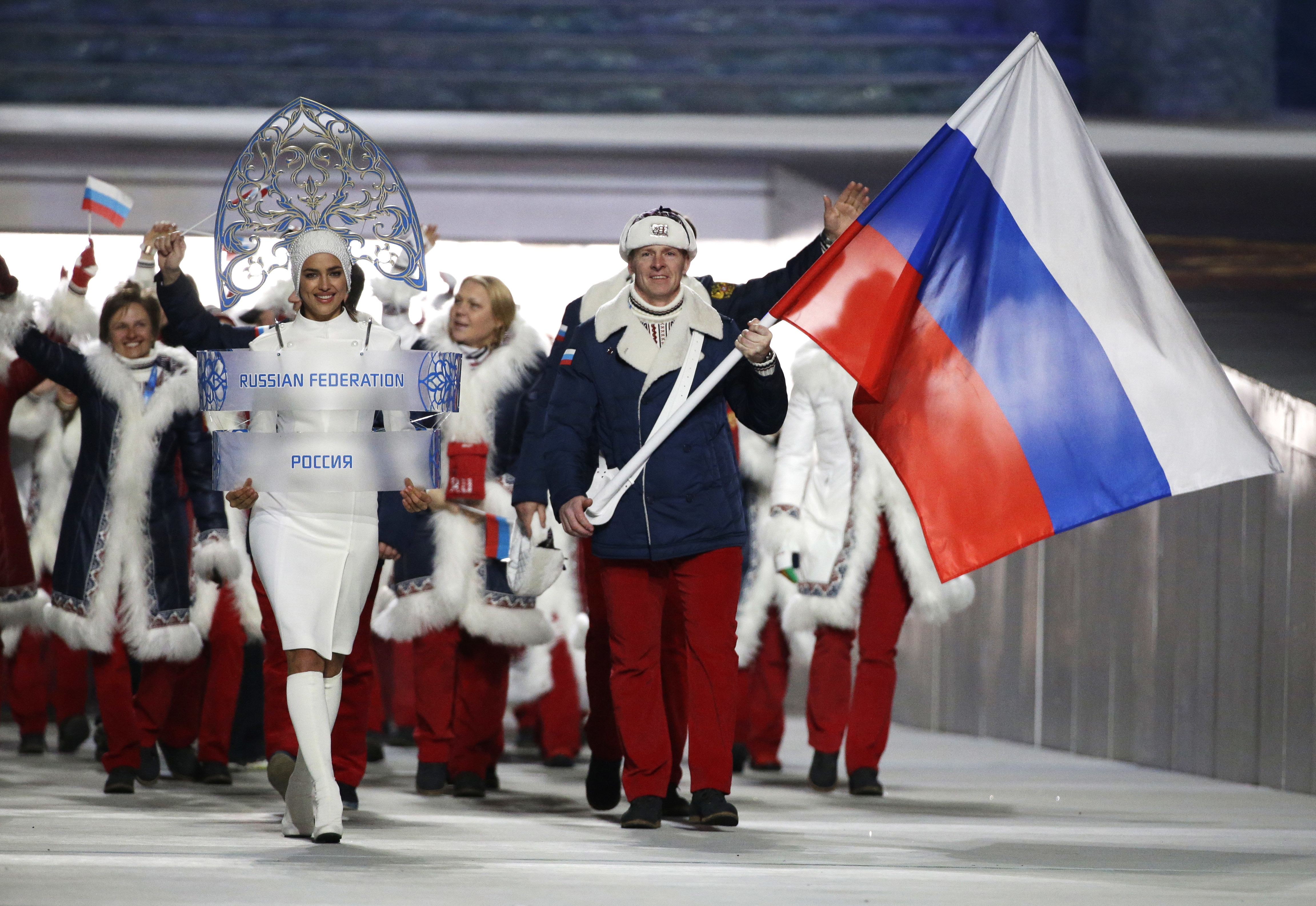 FILE - In this Feb. 7, 2014 file photo Alexander Zubkov of Russia carries the national flag as he leads the team during the opening ceremony of the 2014 Winter Olympics in Sochi, Russia. The Olympic world is bracing for more evidence of systematic Russian