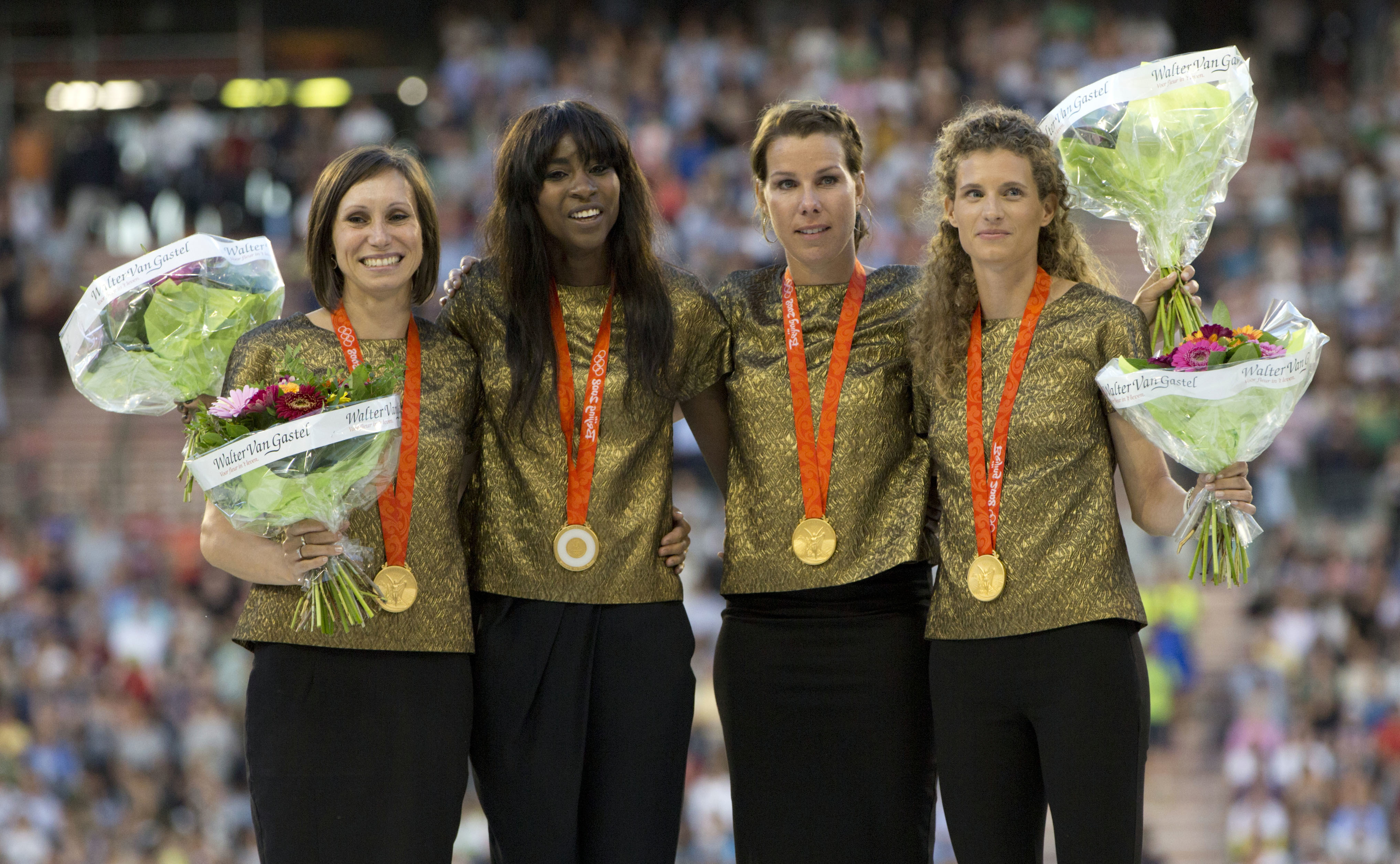 FILE - In this Sept. 9, 2016, file photo, Belgian runners Kim Gevaert, Elodie Ouedraogo, Olivia Borlee and Hanna Marien stand on the podium after receiving the gold medal for the Women's 4 x 100 meters relay at the 2008 Beijing Olympics during the Diamond