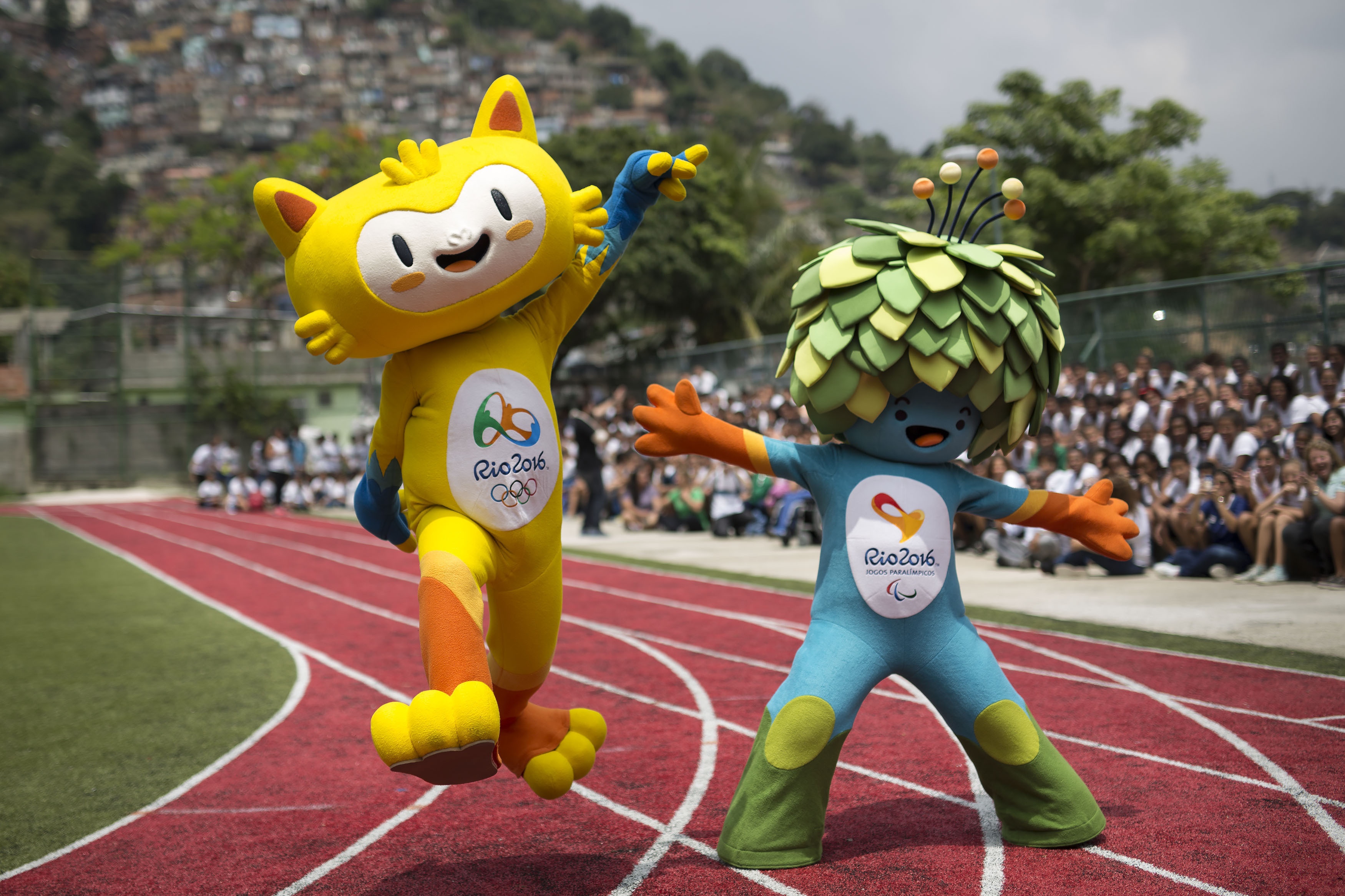 FILE - In this Nov. 24, 2014 file photo, the mascots of the Rio 2016 Olympics, left, and Paralympic Games make their first official appearance at a public school in the Santa Teresa neighborhood of Rio de Janeiro, Brazil.  Almost four months after the Oly