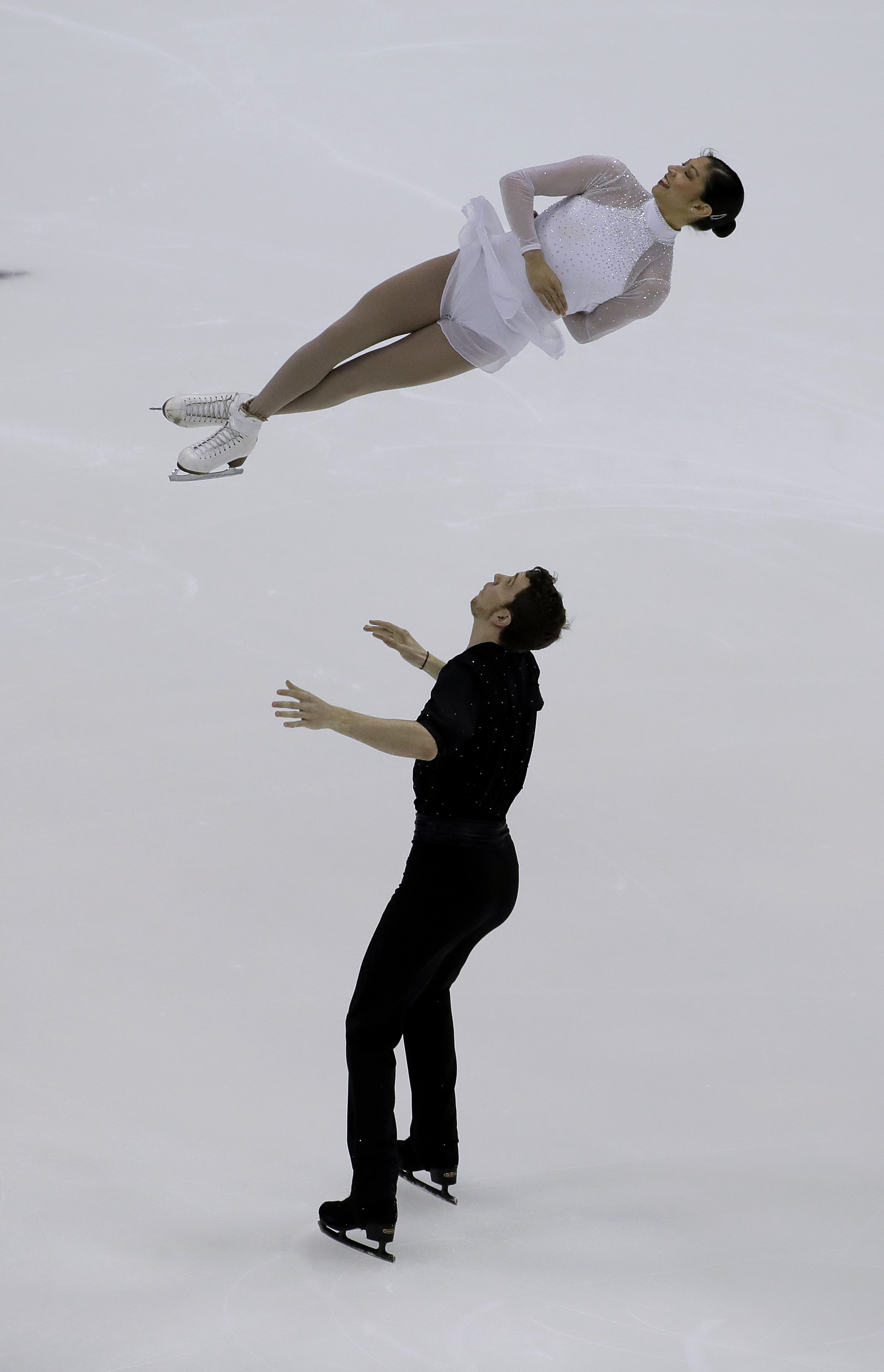Cali Fujimoto and Nicholas Barsi-Rhyne perform in the championship pairs short program during the U.S. Figure Skating Championships Thursday, Jan. 19, 2017, in Kansas City, Mo. (AP Photo/Charlie Riedel)