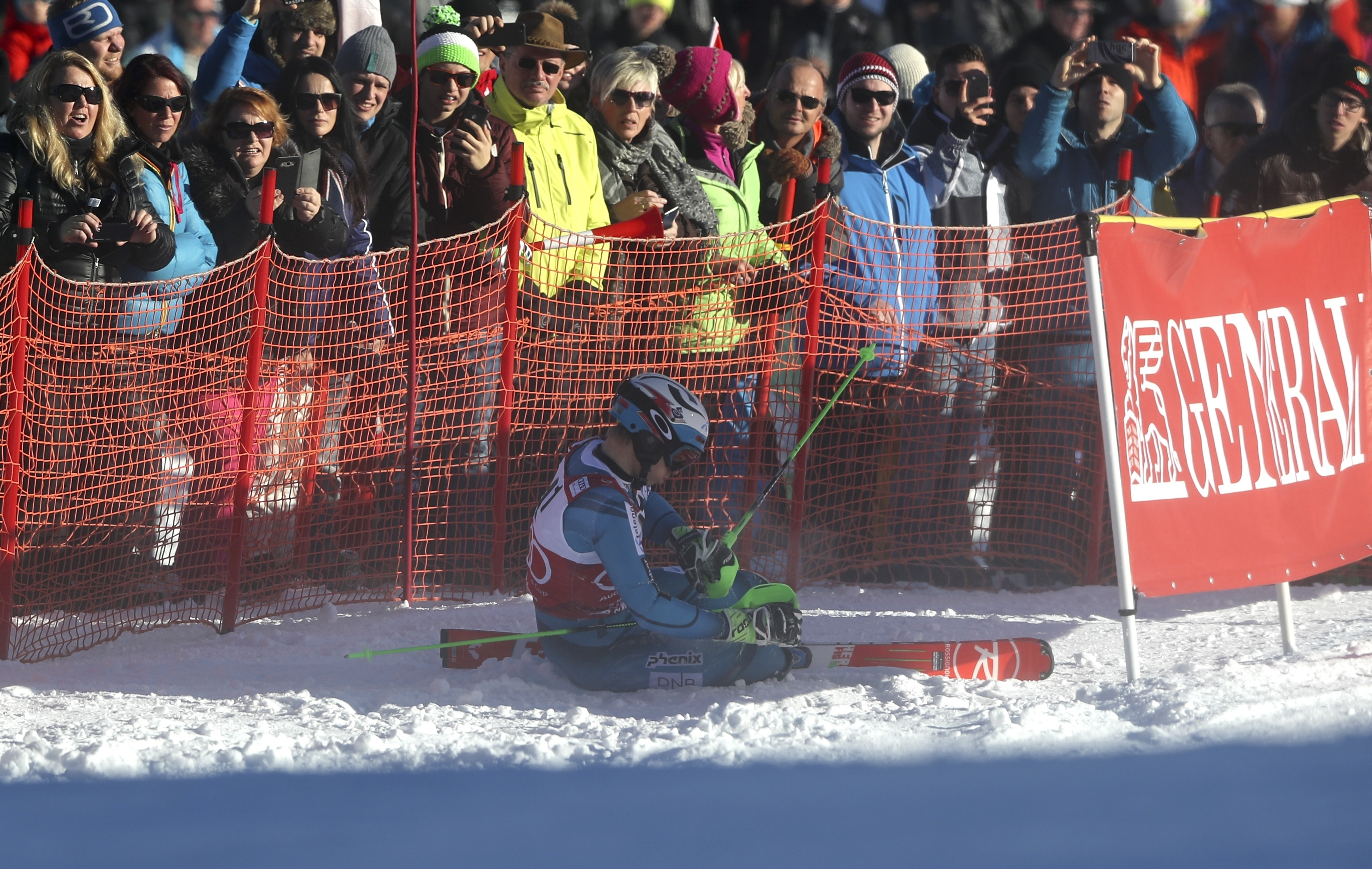 Norway's Henrik Kristoffersen lies in the snow after skiing off course during an alpine ski, men's World Cup slalom, in Kitzbuehel, Austria, Sunday, Jan. 22, 2017. (AP Photo/Shinichiro Tanaka)