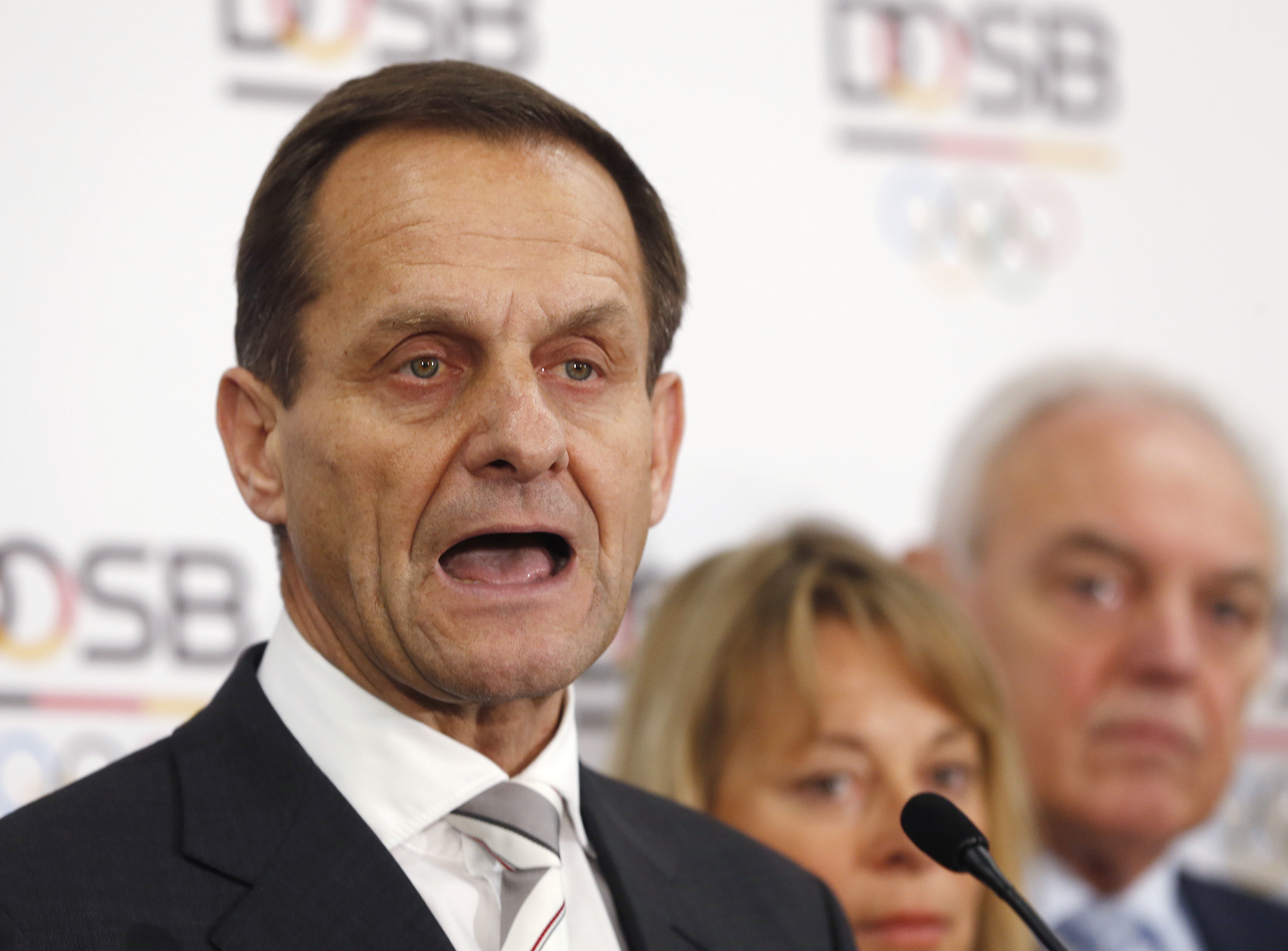 FILE - In this Monday, March 16, 2015 file photo, Alfons Hoermann, President of the German Olympic Sports Confederation DOSB makes a statement to the media, after a meeting in Frankfurt, Germany. The president of the German Olympic Committee has called fo