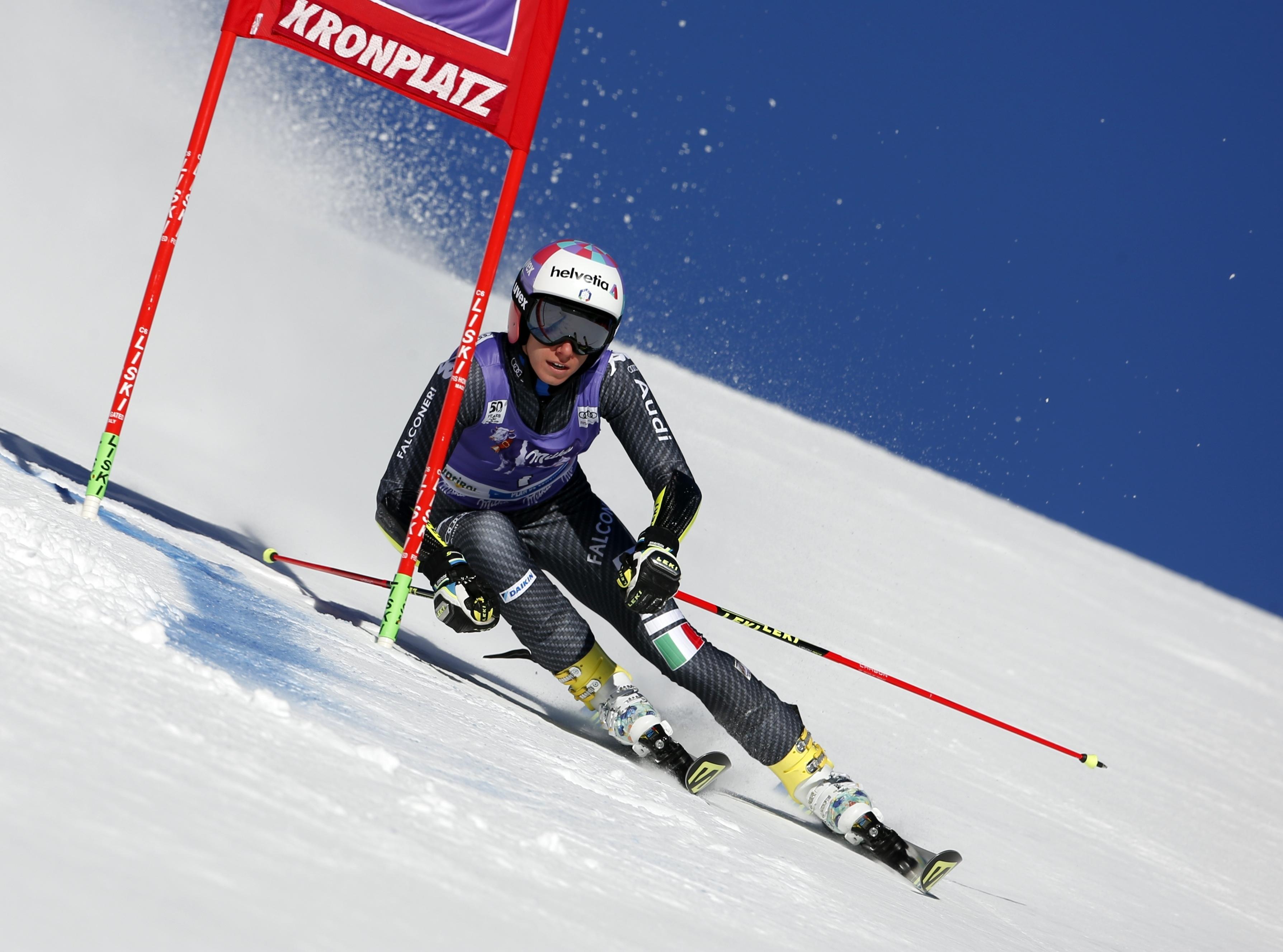 Italy's Marta Bassino speeds down the course during an alpine ski, women's World Cup giant slalom, in San Vigilio di Marebbe, Italy, Tuesday, Jan. 24, 2017. (AP Photo/Marco Trovati)